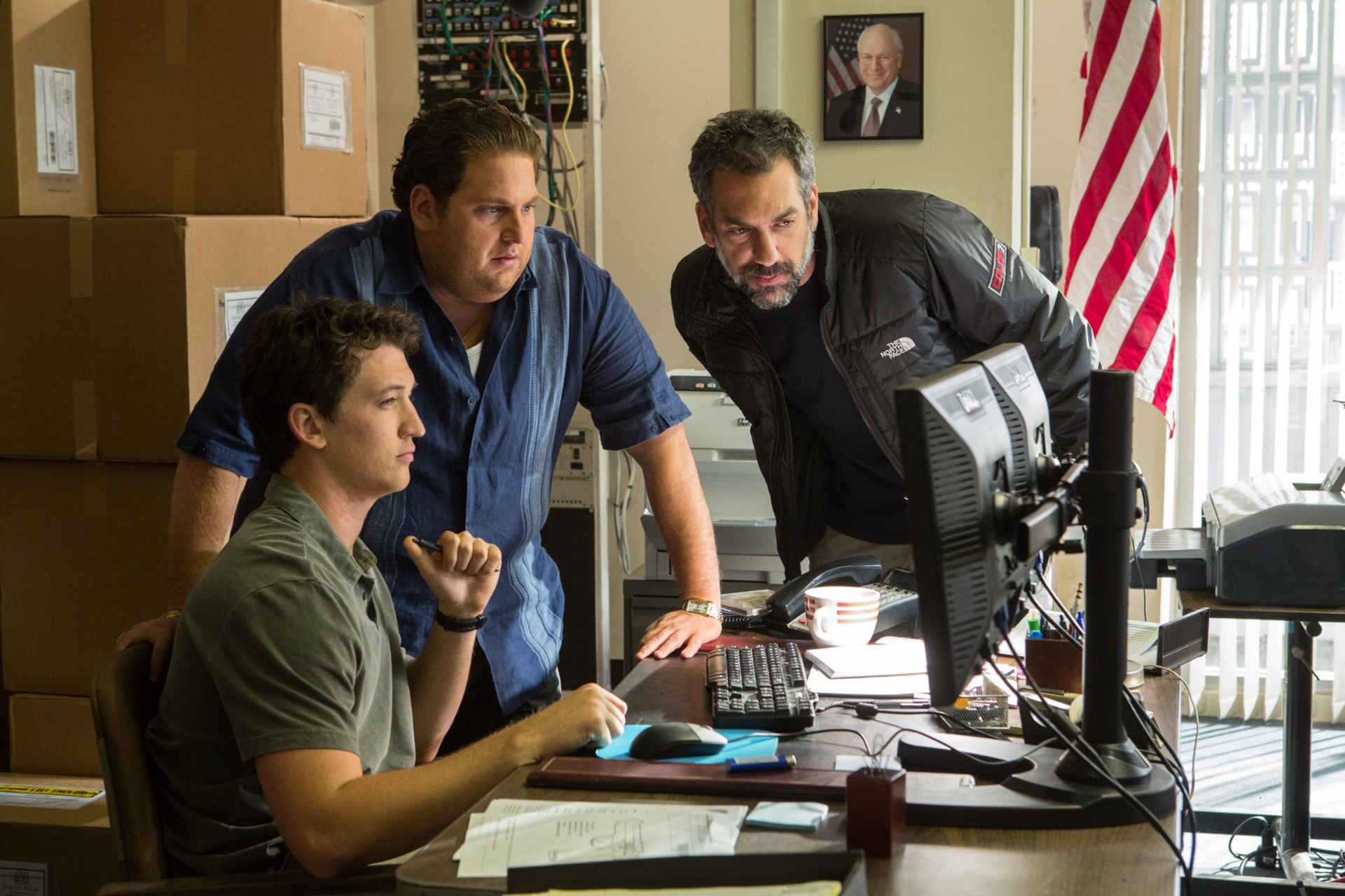"""MILES TELLER, JONAH HILL and director/writer/producer TODD PHILLIPS on the set of Warner Bros. Pictures' comedic drama (based on true events) """"WAR DOGS,"""" a Warner Bros. Pictures release."""