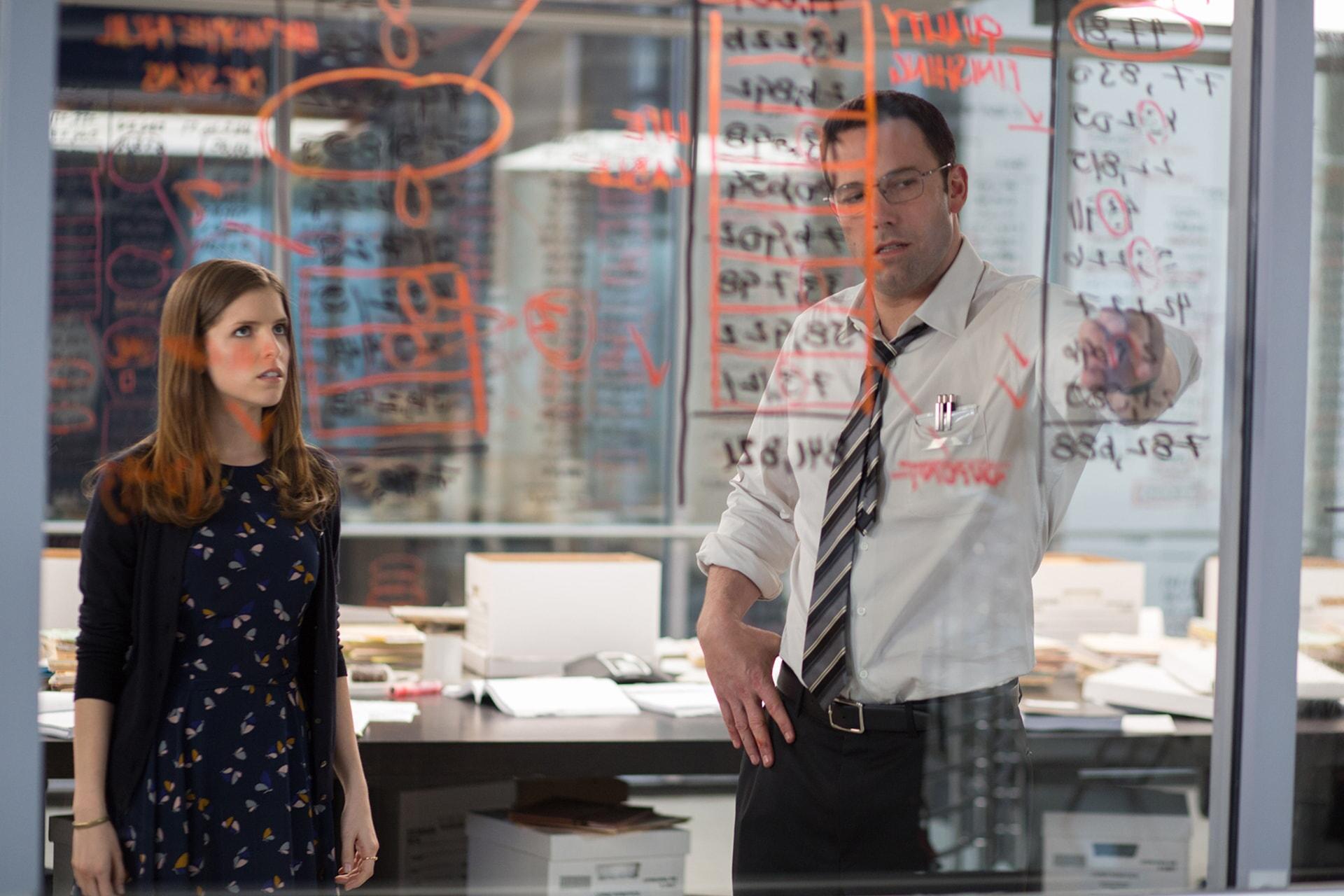 ANNA KENDRICK as Dana and BEN AFFLECK as Christian working out a math problem