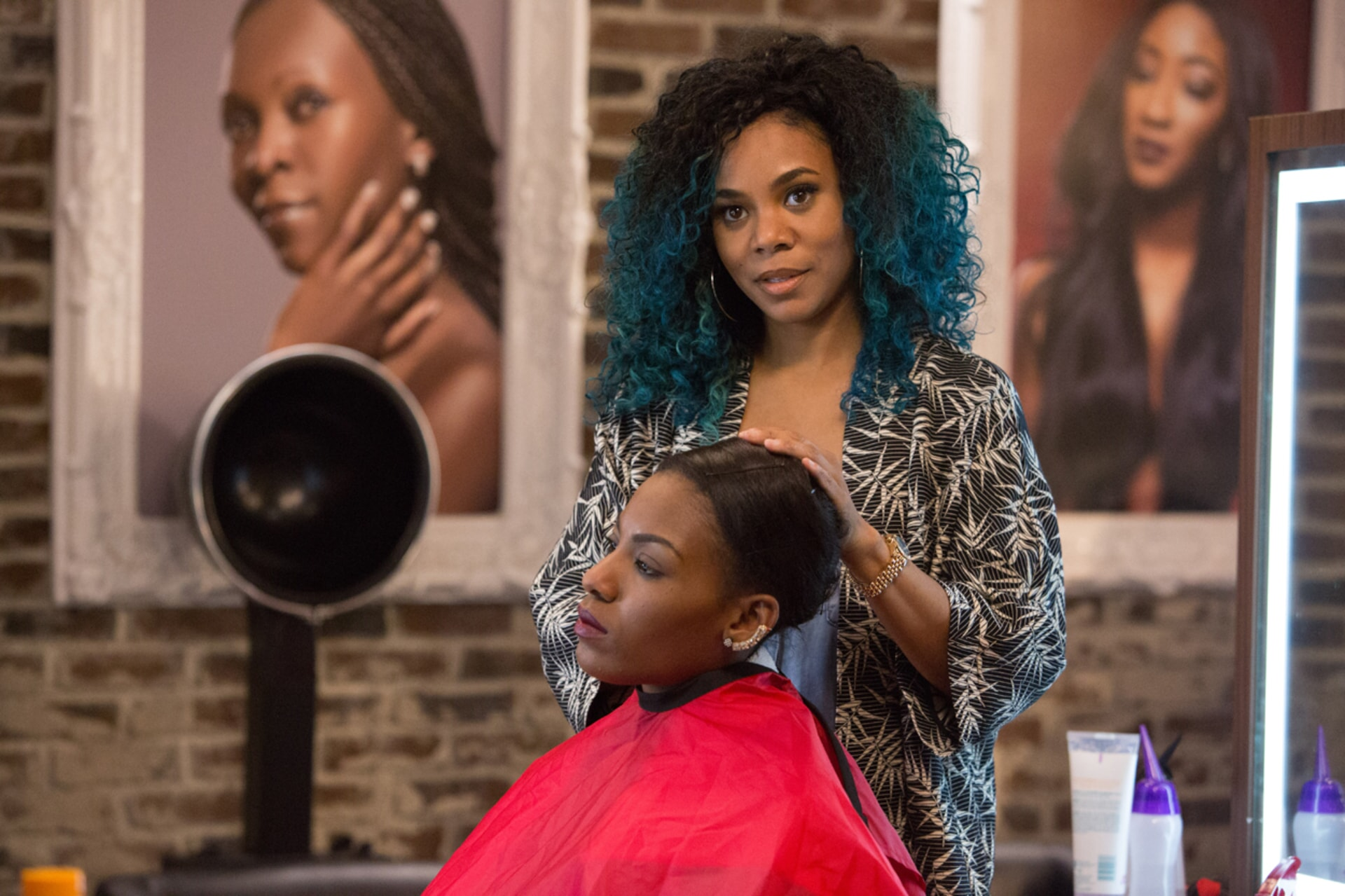 (Standing) REGINA HALL as Angie in Barbershop: The Next Cut