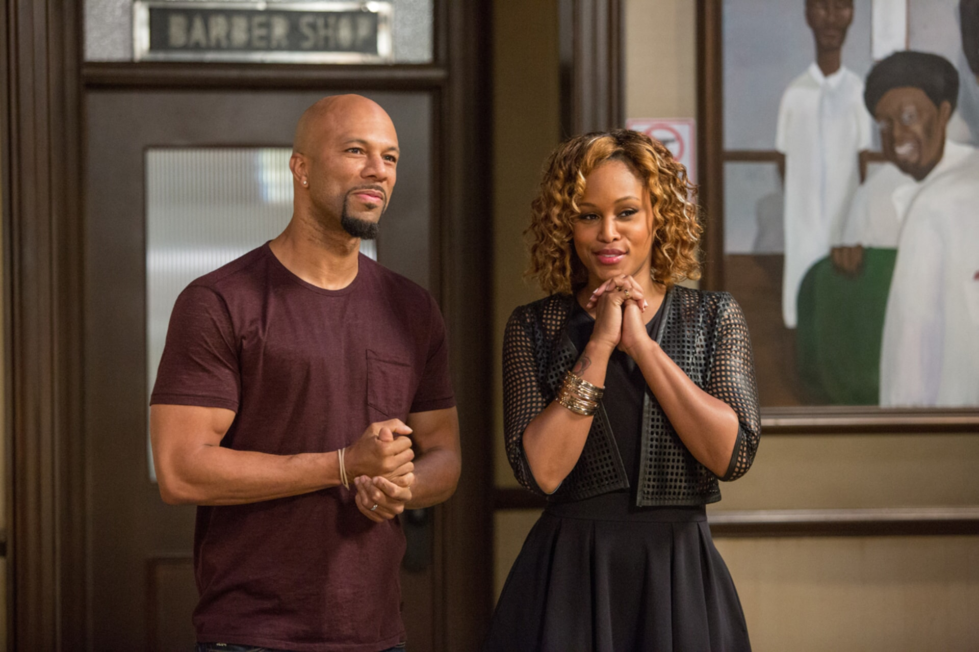 COMMON as Rashad and EVE as Terri in Barbershop: The Next Cut