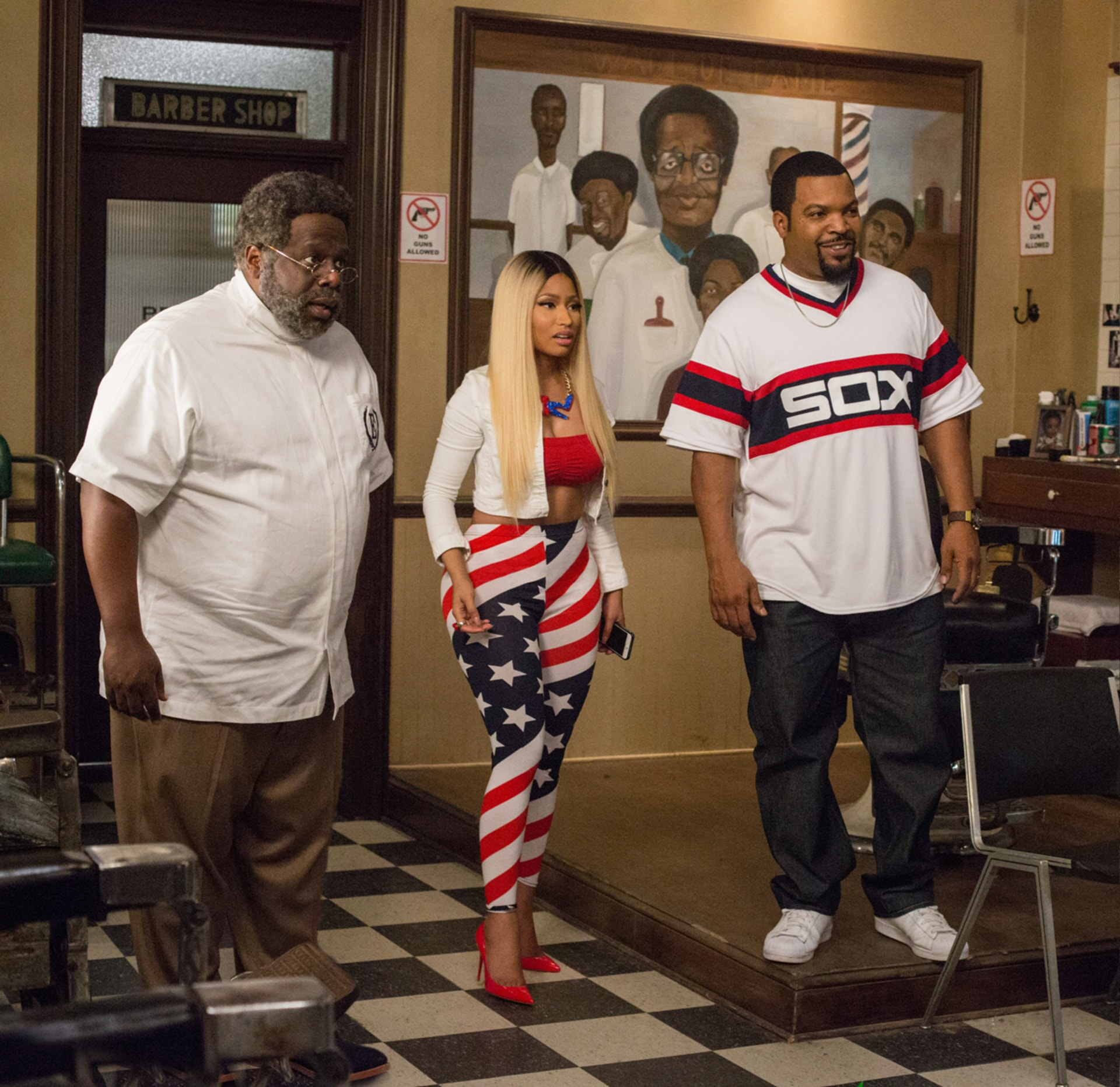 """CEDRIC THE ENTERTAINER as Eddie, NICKI MINAJ as Draya and ICE CUBE as Calvin in New Line Cinema's and Metro-Goldwyn-Mayer Pictures' comedy """"BARBERSHOP: THE NEXT CUT, """" a Warner Bros. Pictures release."""