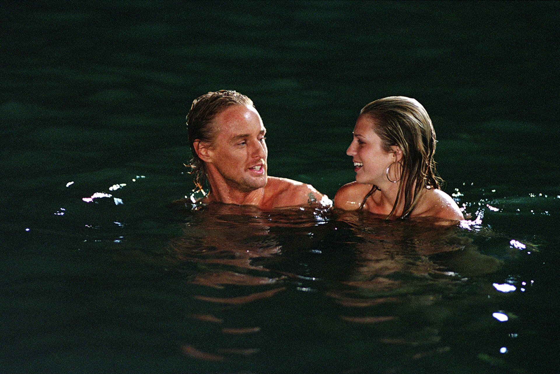 owen wilson and sara foster taking a swim in the big bounce