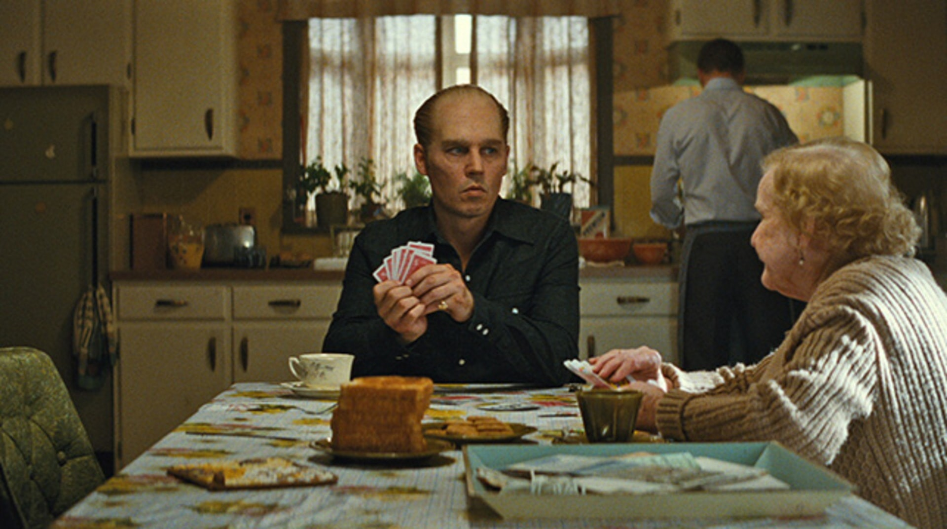 """JOHNNY DEPP as Whitey Bulger and MARY KLUG as Ma Bulger in the drama """"BLACK MASS."""""""