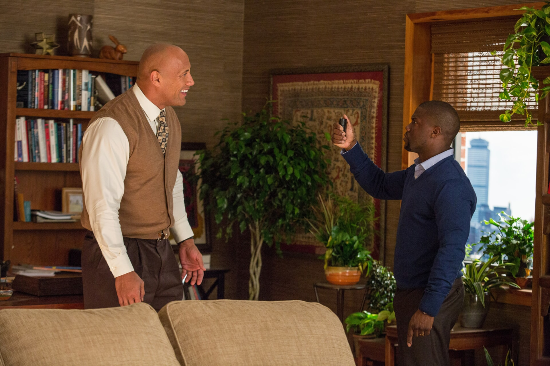 DWAYNE JOHNSON as Bob and KEVIN HART as Calvin in an office