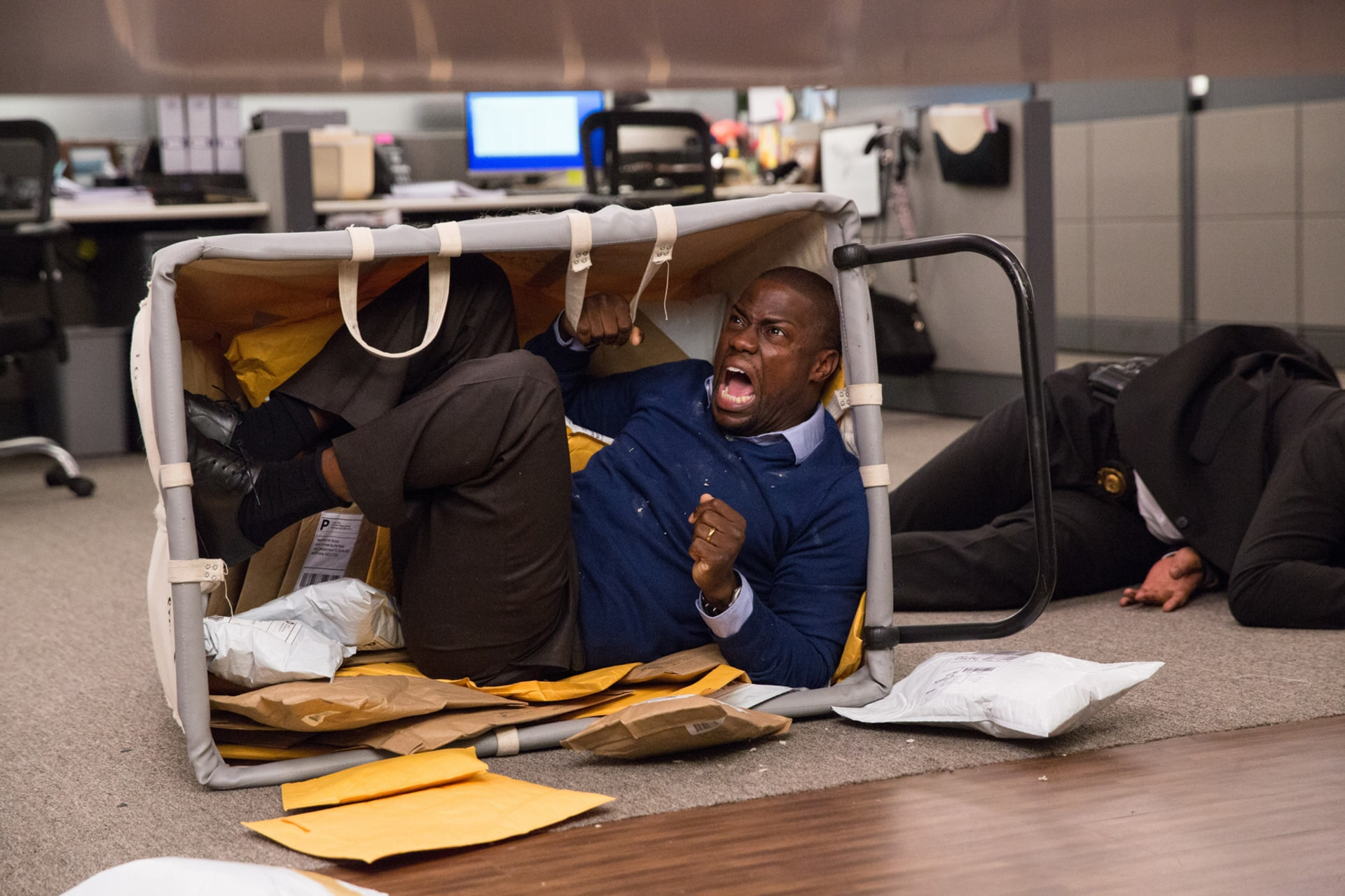 KEVIN HART as Calvin hiding in a mail cart