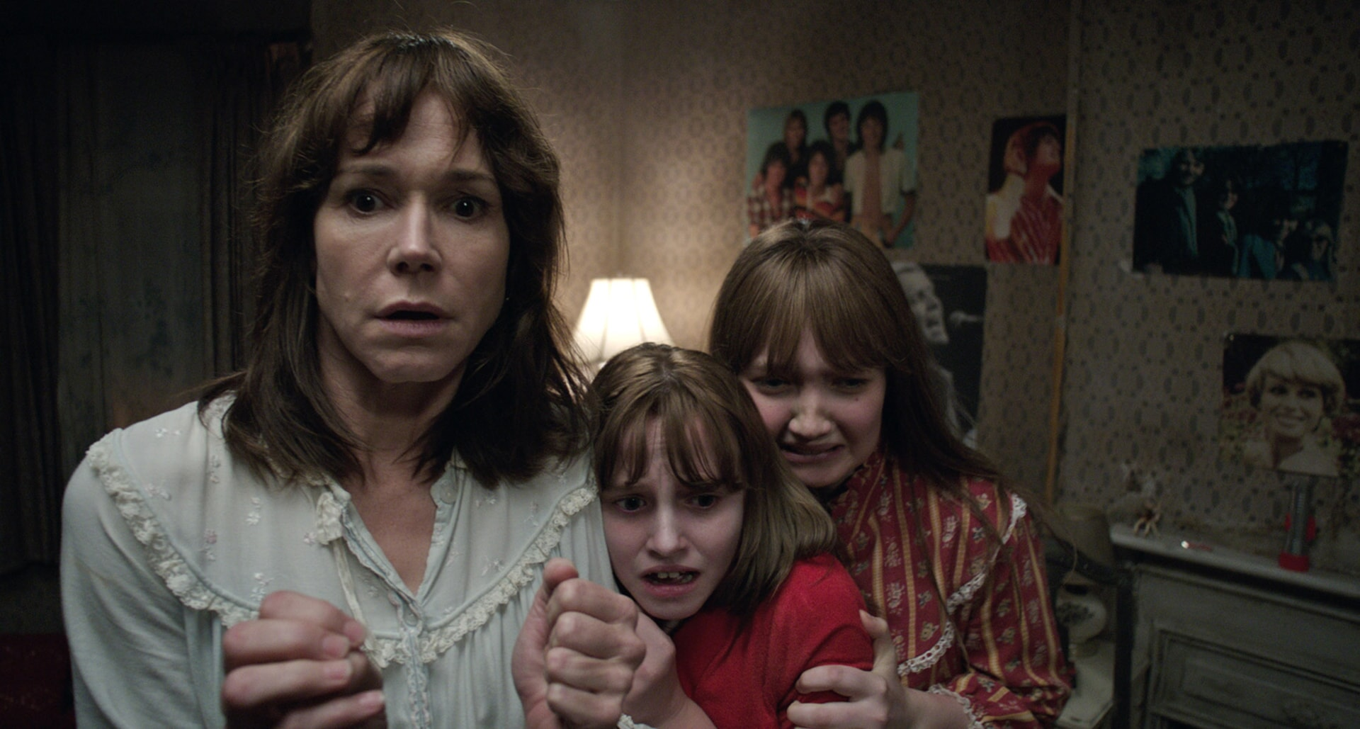 FRANCES O'CONNOR as Peggy Hodgson, MADISON WOLFE as Janet Hodgson and LAUREN ESPOSITO as Margaret Hodgson huddled together with frightened expressions