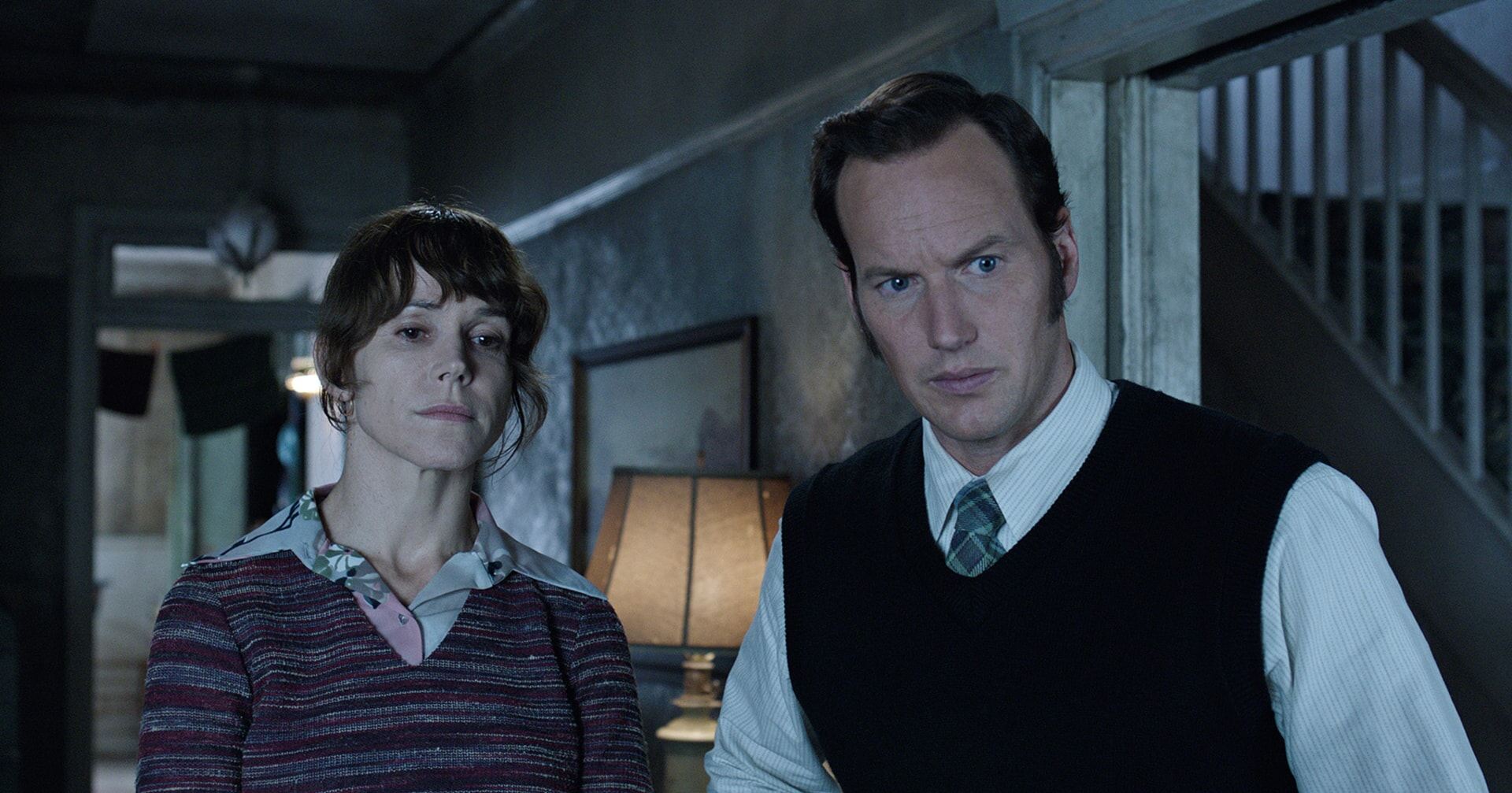 FRANCES O'CONNOR as Peggy Hodgson and PATRICK WILSON as Ed Warren standing next to each other