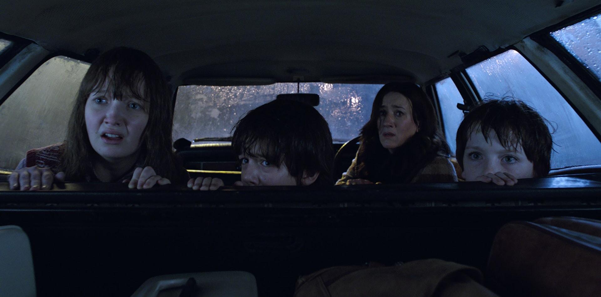 LAUREN ESPOSITO as Margaret Hodgson, PATRICK McAULEY as Johnny Hodgson, MARIA DOYLE KENNEDY as Peggy Nottingham and BENJAMIN HAIGH as Billy Hodgson in a car looking fearful
