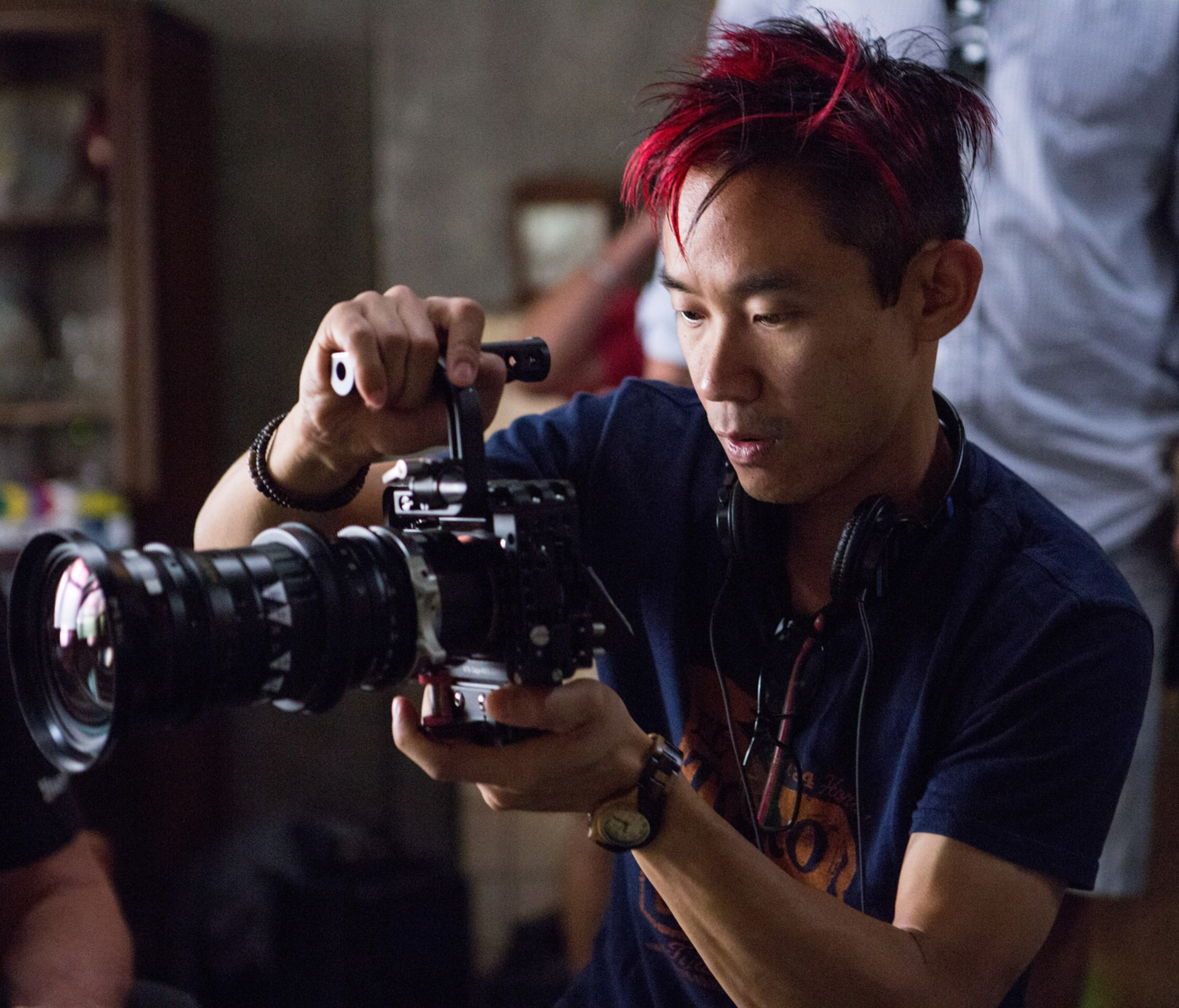 Director/writer/producer JAMES WAN on the set of The Conjuring 2 checking a camera
