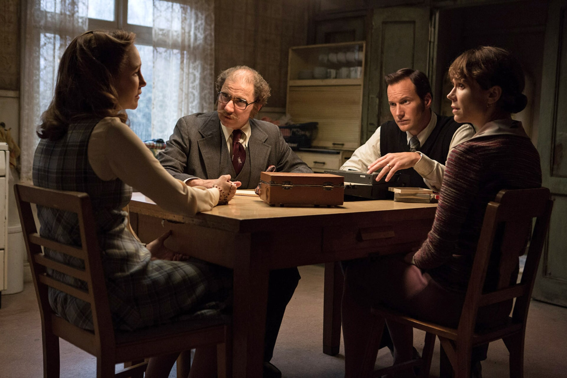 """VERA FARMIGA as Lorraine Warren, SIMON McBURNEY as Maurice Grosse, PATRICK WILSON as Ed Warren and FRANCES O'CONNOR as Peggy Hodgson, in New Line Cinema's supernatural thriller """"THE CONJURING 2,"""" a Warner Bros. Pictures release."""