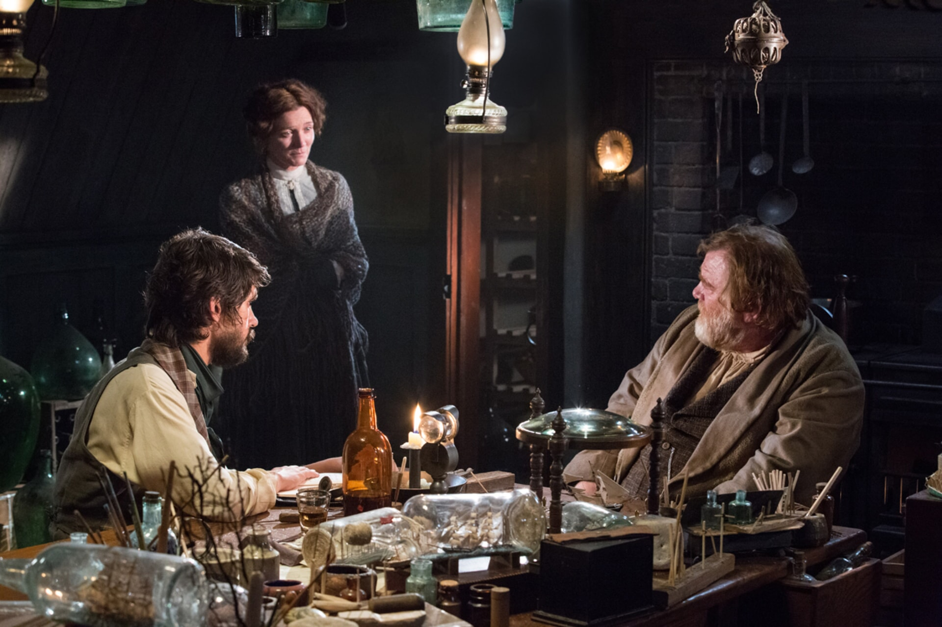 "BEN WHISHAW as Herman Melville, MICHELLE FAIRLEY as Mrs. Nickerson and BRENDAN GLEESON as Tom Nickerson in Warner Bros. Pictures' and Village Roadshow Pictures' action adventure ""IN THE HEART OF THE SEA,"" distributed worldwide by Warner Bros. Pictures and in select territories by Village Roadshow Pictures."