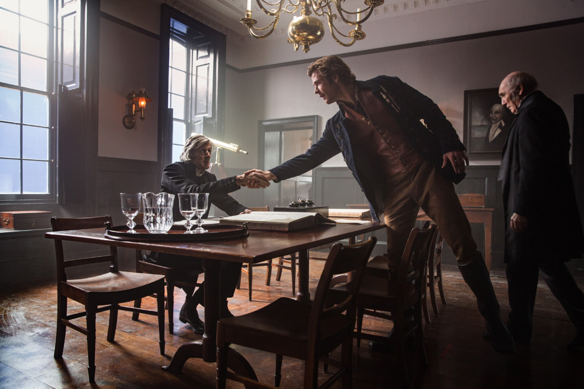 "RICHARD BREMMER as Benjamin Fuller, CHRIS HEMSWORTH as Owen Chase and DONALD SUMPTER as Paul Mason in Warner Bros. Pictures' and Village Roadshow Pictures' action adventure ""IN THE HEART OF THE SEA,"" distributed worldwide by Warner Bros. Pictures and in select territories by Village Roadshow Pictures."