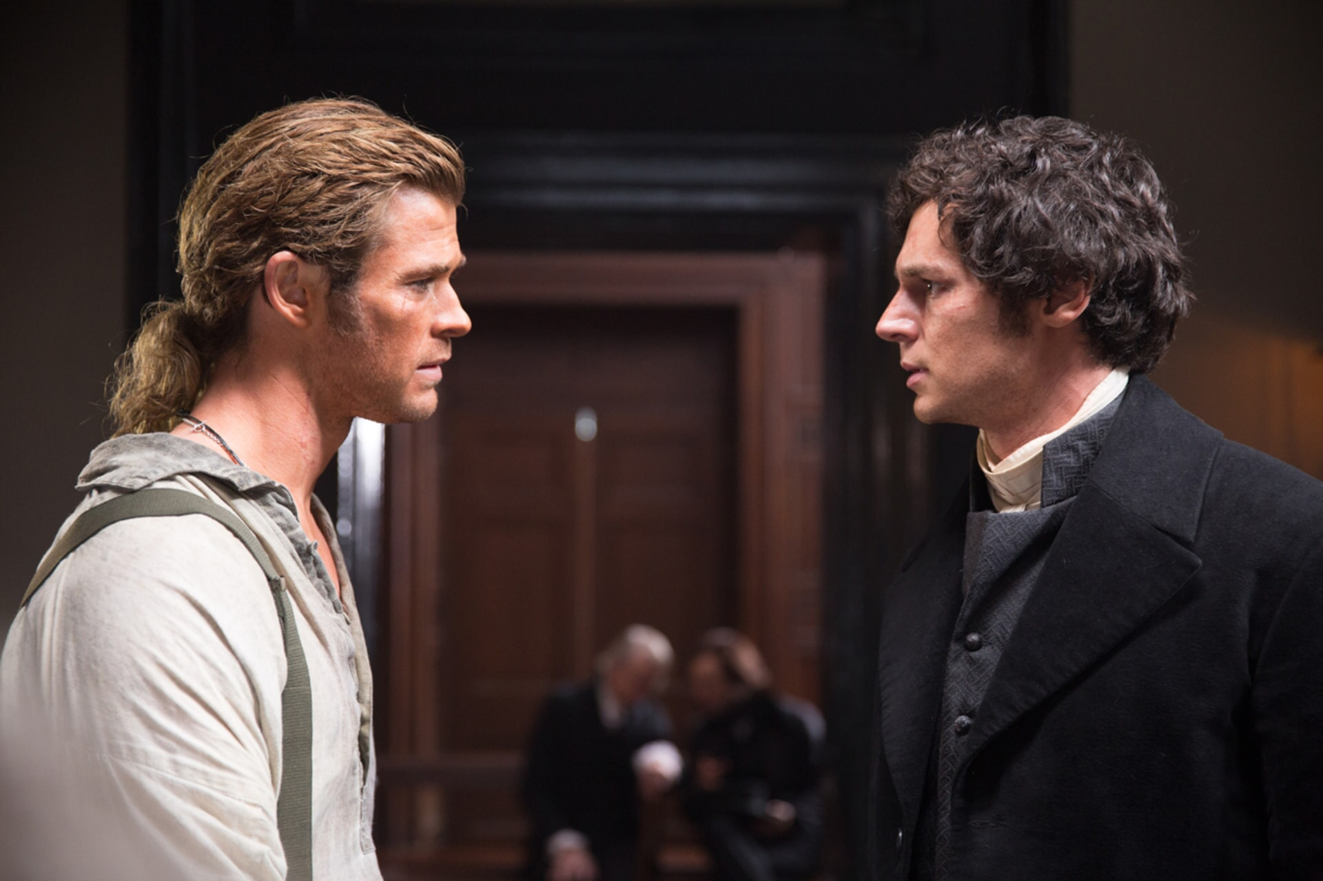 "CHRIS HEMSWORTH as Owen Chase and BENJAMIN WALKER as George Pollard in Warner Bros. Pictures' and Village Roadshow Pictures' action adventure ""IN THE HEART OF THE SEA,"" distributed worldwide by Warner Bros. Pictures and in select territories by Village Roadshow Pictures."