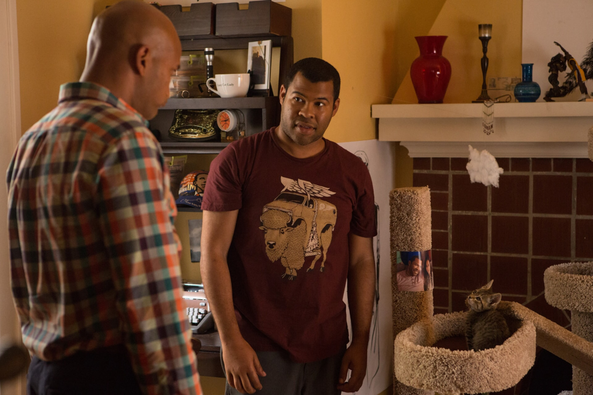 KEEGAN-MICHAEL KEY as Clarence Goobril and JORDAN PEELE as Rell Williams looking at Keanu the kitten in his cat bed
