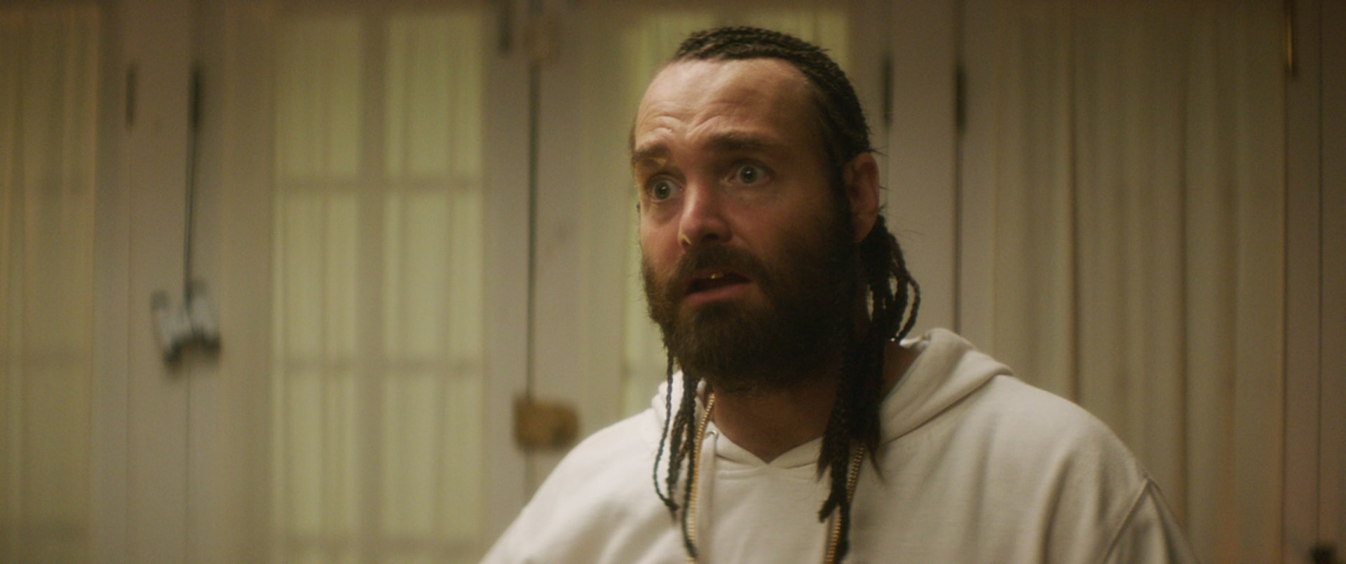WILL FORTE as Hulka with braided hair and beard