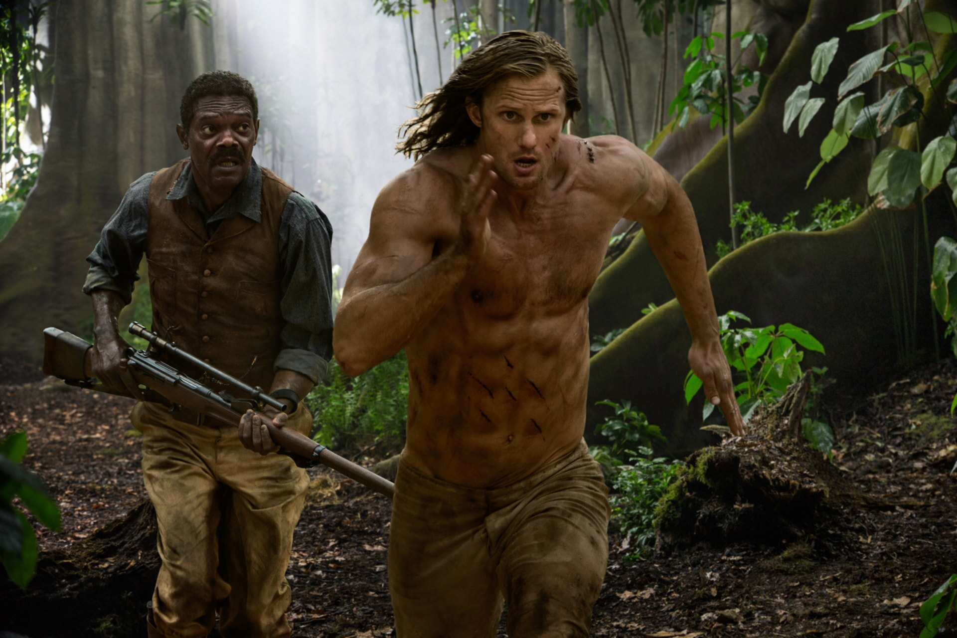 SAMUEL L. JACKSON as George Washington Williams and ALEXANDAR SKARSGÅRD as Tarzan run through the jungle
