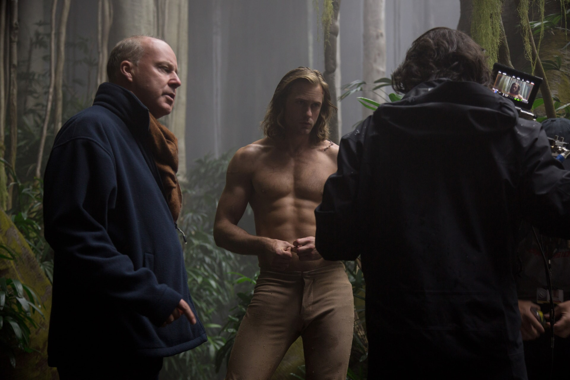 DAVID YATES (left) and ALEXANDER SKARSGÅRD (center) behind the scenes on the set