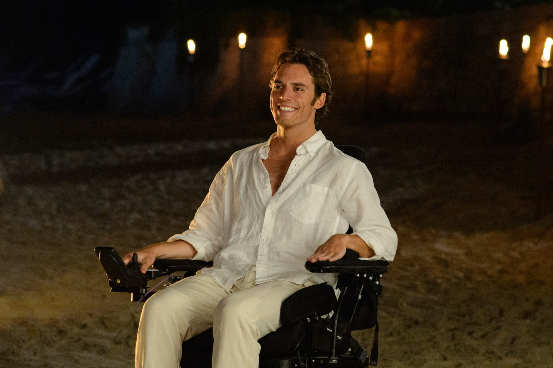 SAM CLAFLIN as Will Traynor on a beach at nighttime.