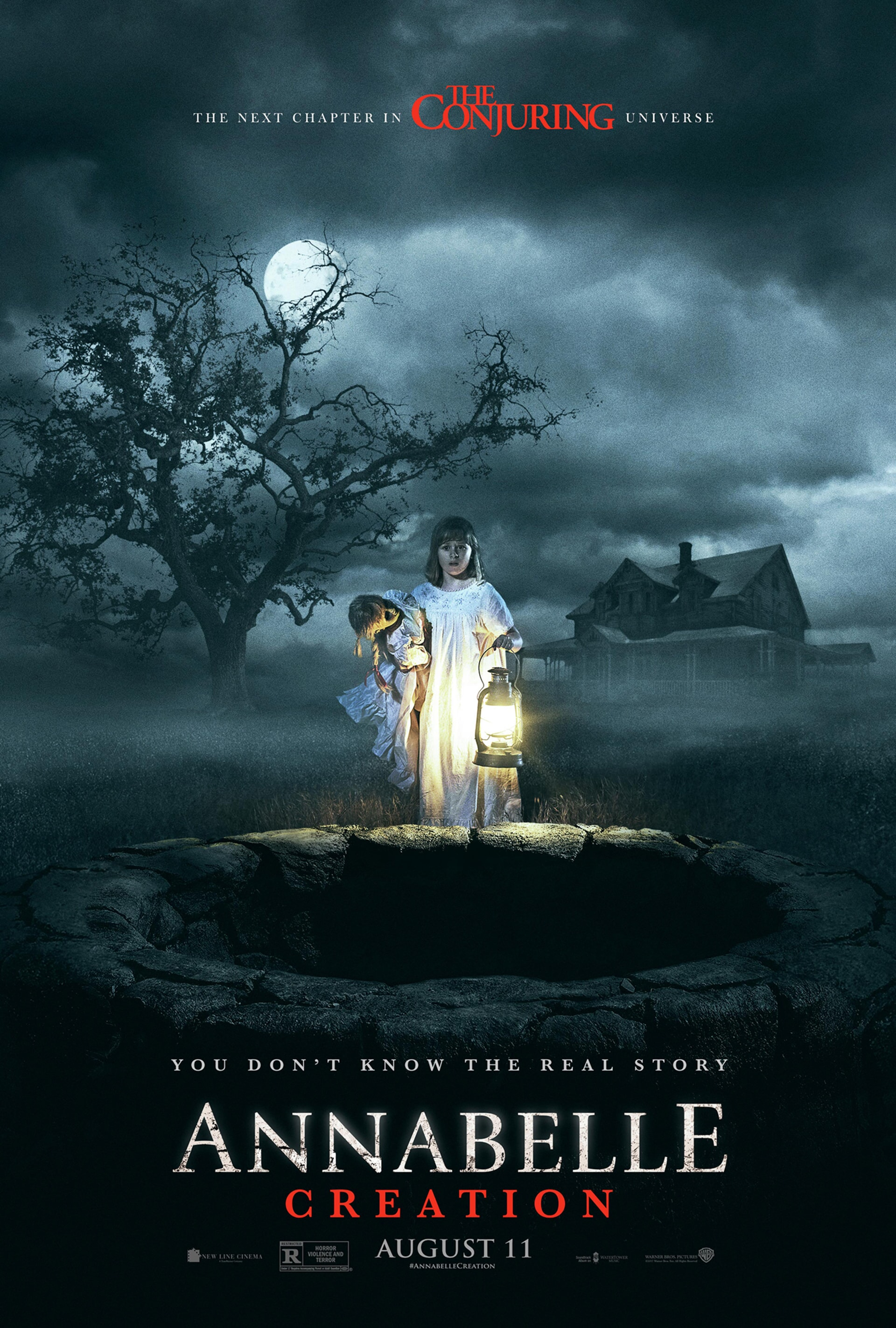 Girl holding Annabelle doll next to a well