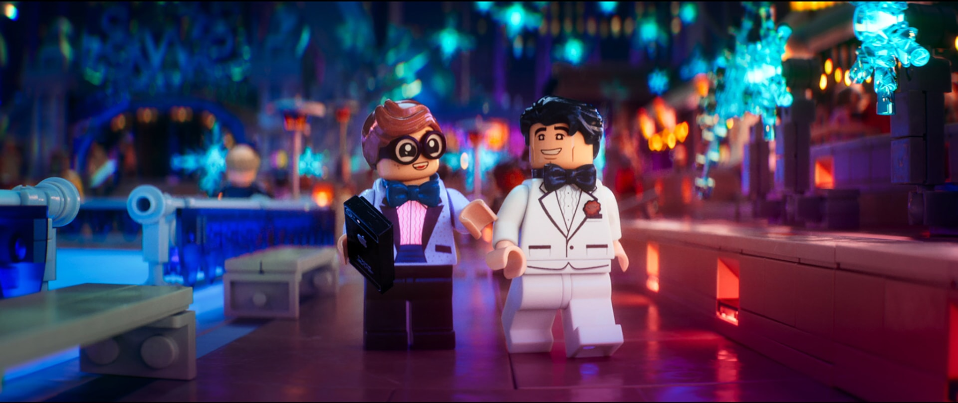 "(L-R) LEGO® minifigures Dick Grayson (MICHAEL CERA) and Bruce Wayne (WILL ARNETT) in the animated adventure ""The LEGO Batman Movie,"""
