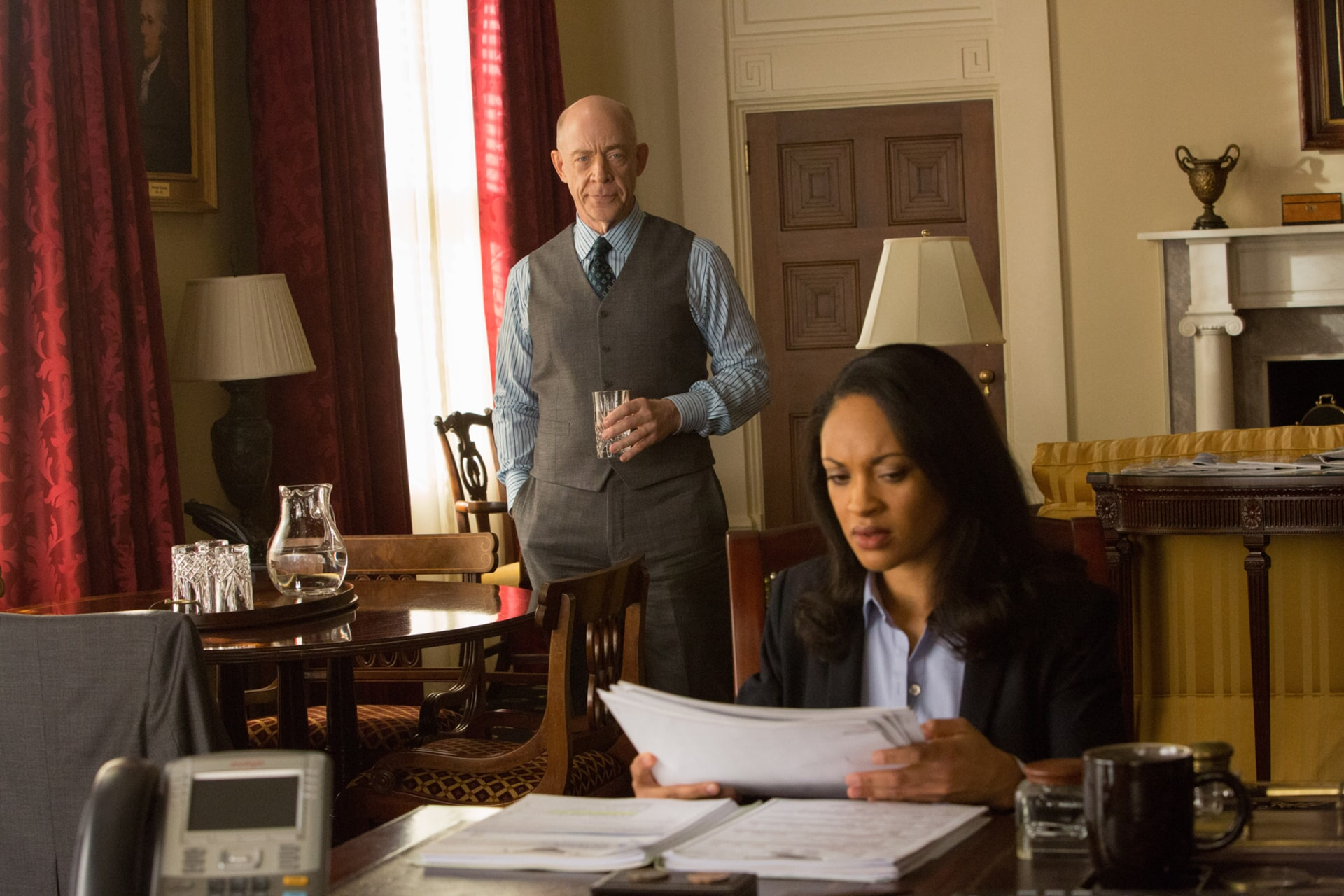 "J.K. SIMMONS as Ray King and CYNTHIA ADDAI-ROBINSON as Marybeth Medina in Warner Bros. Pictures' ""THE ACCOUNTANT,"" a Warner Bros. Pictures release."