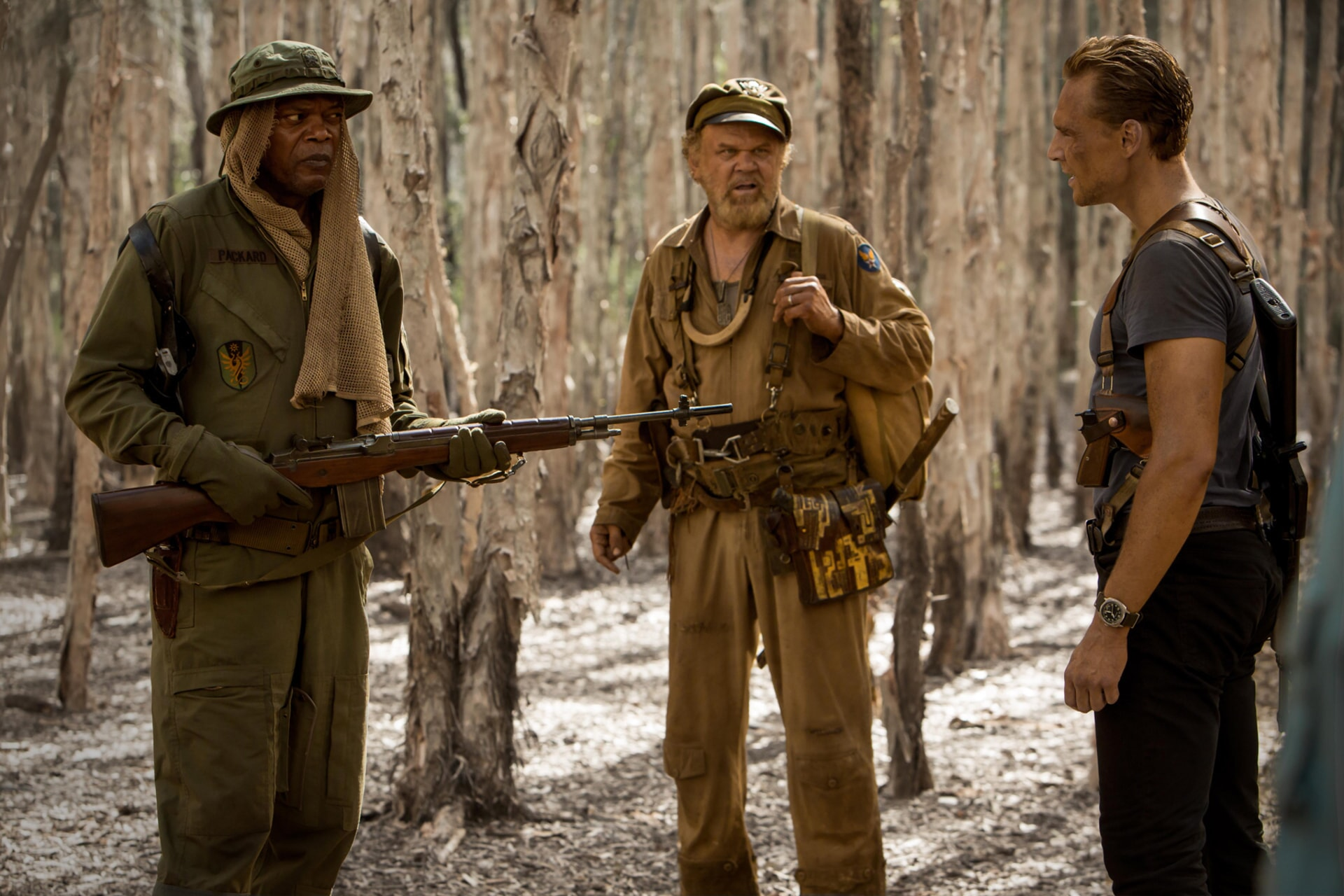 """SAMUEL L. JACKSON as Preston Packard, JOHN C. REILLY as Hank Marlow and TOM HIDDLESTON as James Conrad in Warner Bros. Pictures', Legendary Pictures' and Tencent Pictures' action adventure """"KONG: SKULL ISLAND,"""" a Warner Bros. Pictures release."""