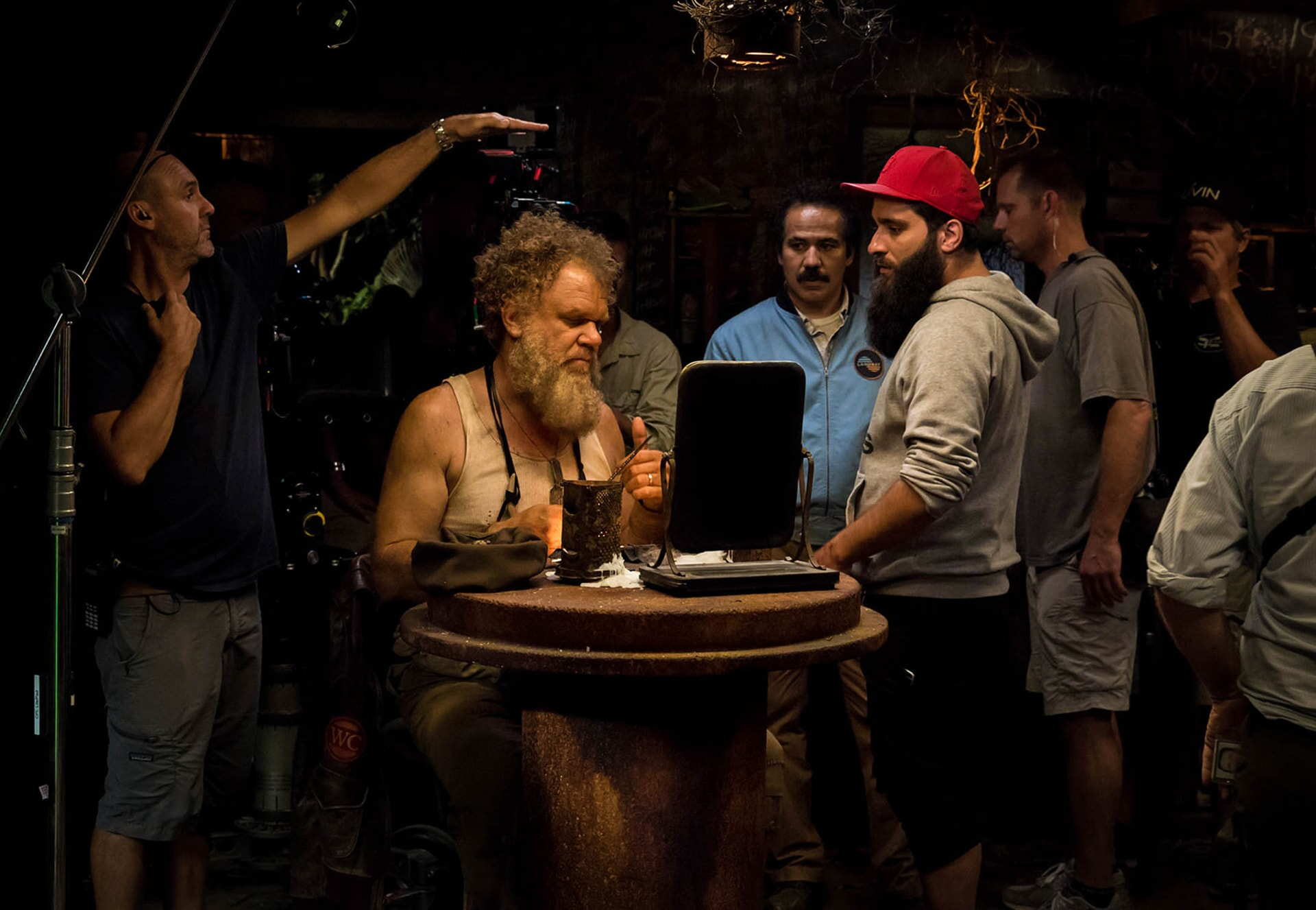 """JOHN C. REILLY, JOHN ORTIZ and director JORDAN VOGT-ROBERTS on the set of Warner Bros. Pictures', Legendary Pictures' and Tencent Pictures' action adventure """"KONG: SKULL ISLAND,"""" a Warner Bros. Pictures release."""