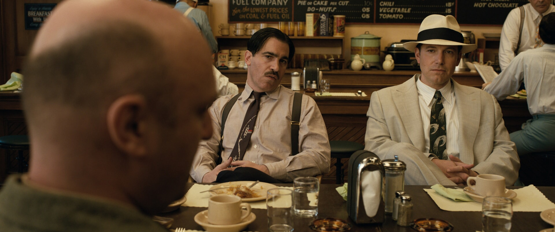 "CHRIS MESSINA as Dion Bartolo and BEN AFFLECK as Joe Coughlin in Warner Bros. Pictures' dramatic crime thriller ""LIVE BY NIGHT,"" a Warner Bros. Pictures release."