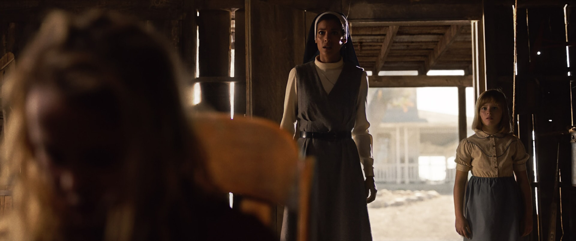 """STEPHANIE SIGMAN as Sister Charlotte and LULU WILSON as Linda in New Line Cinema's supernatural thriller """"ANNABELLE: CREATION,"""" a Warner Bros. Pictures release."""