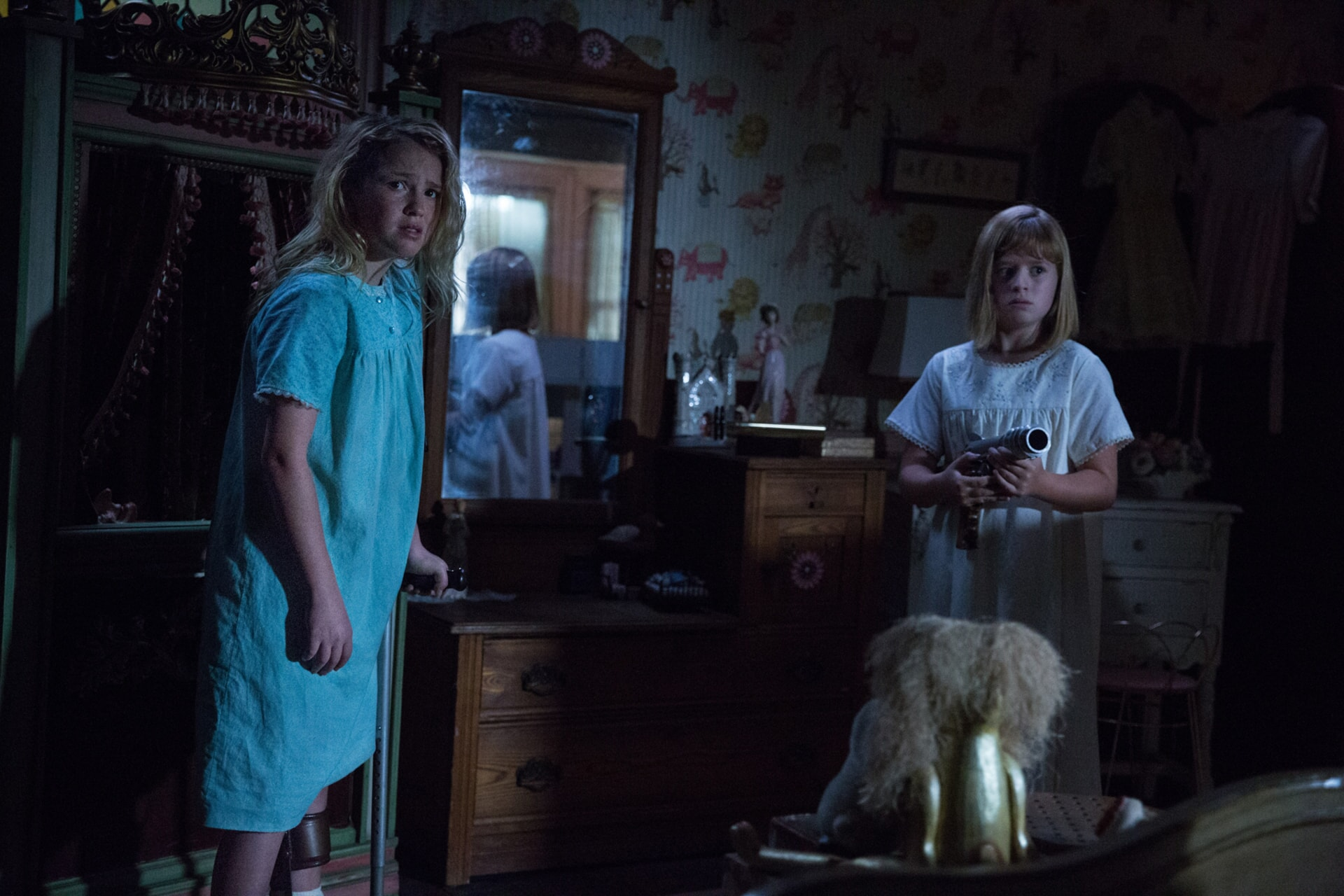 """TALITHA BATEMAN as Janice and LULU WILSON as Linda in New Line Cinema's supernatural thriller """"ANNABELLE: CREATION,"""" a Warner Bros. Pictures release."""