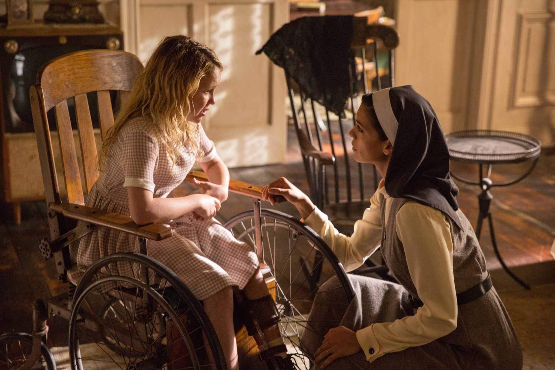 """TALITHA BATEMAN as Janice and STEPHANIE SIGMAN as Sister Charlotte in New Line Cinema's supernatural thriller """"ANNABELLE: CREATION,"""" a Warner Bros. Pictures release."""