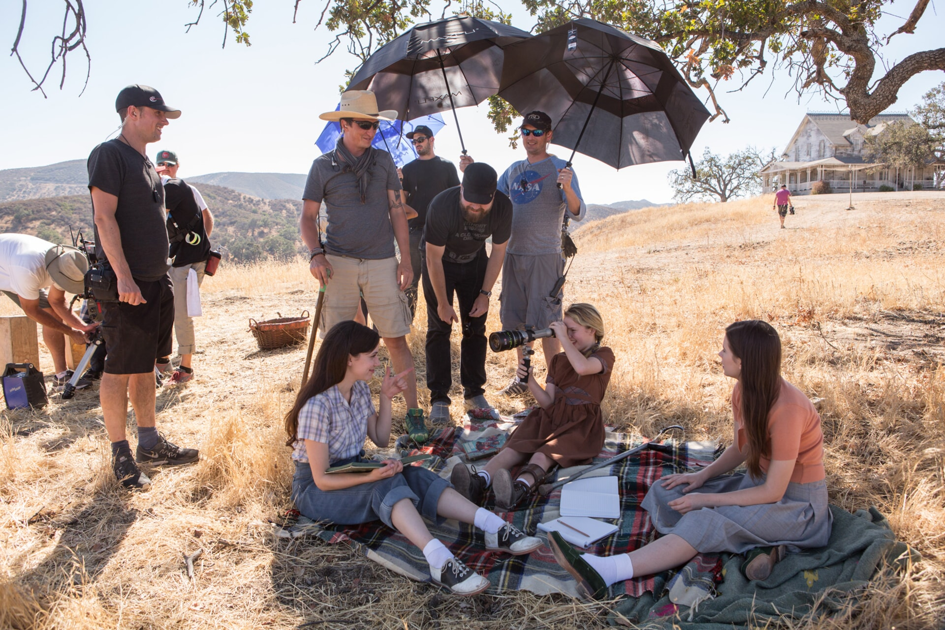"""(Center L-R) GRACE FULTON, director of photography MAXIME ALEXANDRE, director DAVID F. SANDBERG, (sitting) TALITHA BATEMAN and PHILIPPA COULTHARD on the set of New Line Cinema's supernatural thriller """"ANNABELLE: CREATION,"""" a Warner Bros. Pictures release."""