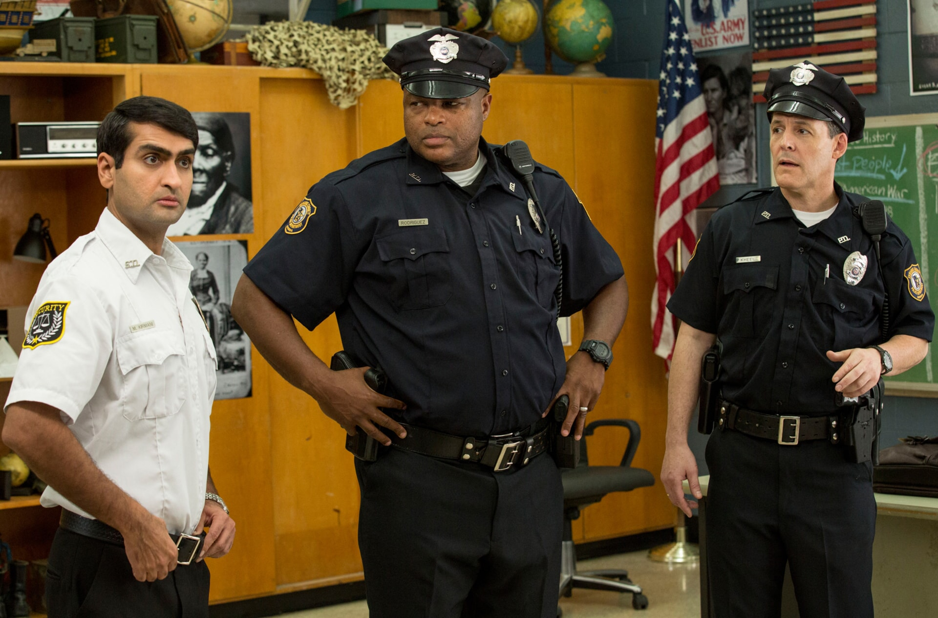 """KUMAIL NANJIANI as Mehar, MICHAEL BEASLEY as Officer Rodriguez and ROBERT PRALGO as Officer Kheel in the New Line Cinema and Village Roadshow Pictures comedy """"FIST FIGHT,"""" a Warner Bros. Pictures release."""