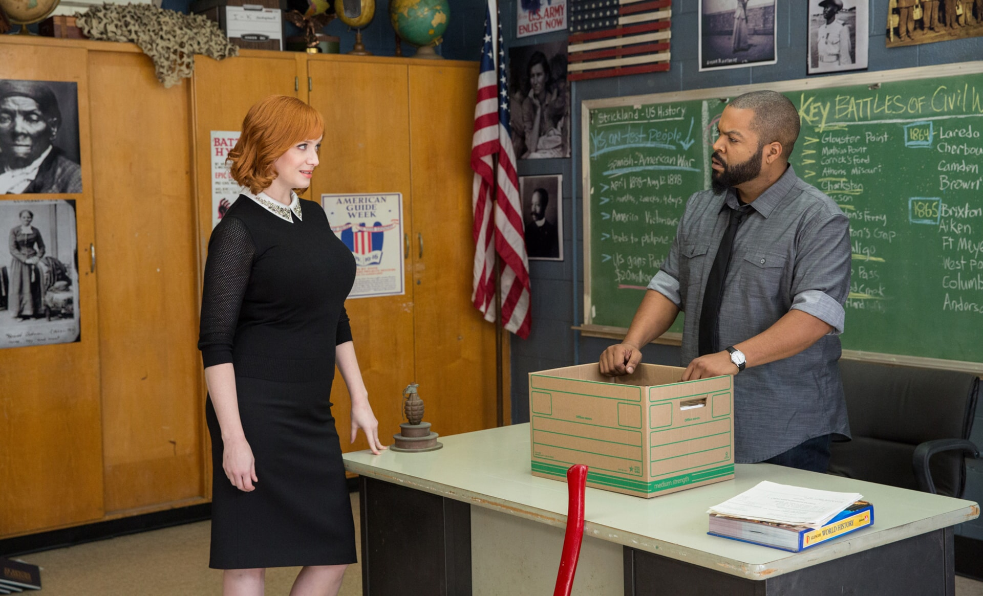 "CHRISTINA HENDRICKS as Ms. Monet and ICE CUBE as Strickland in the New Line Cinema and Village Roadshow Pictures comedy ""FIST FIGHT,"" a Warner Bros. Pictures release."