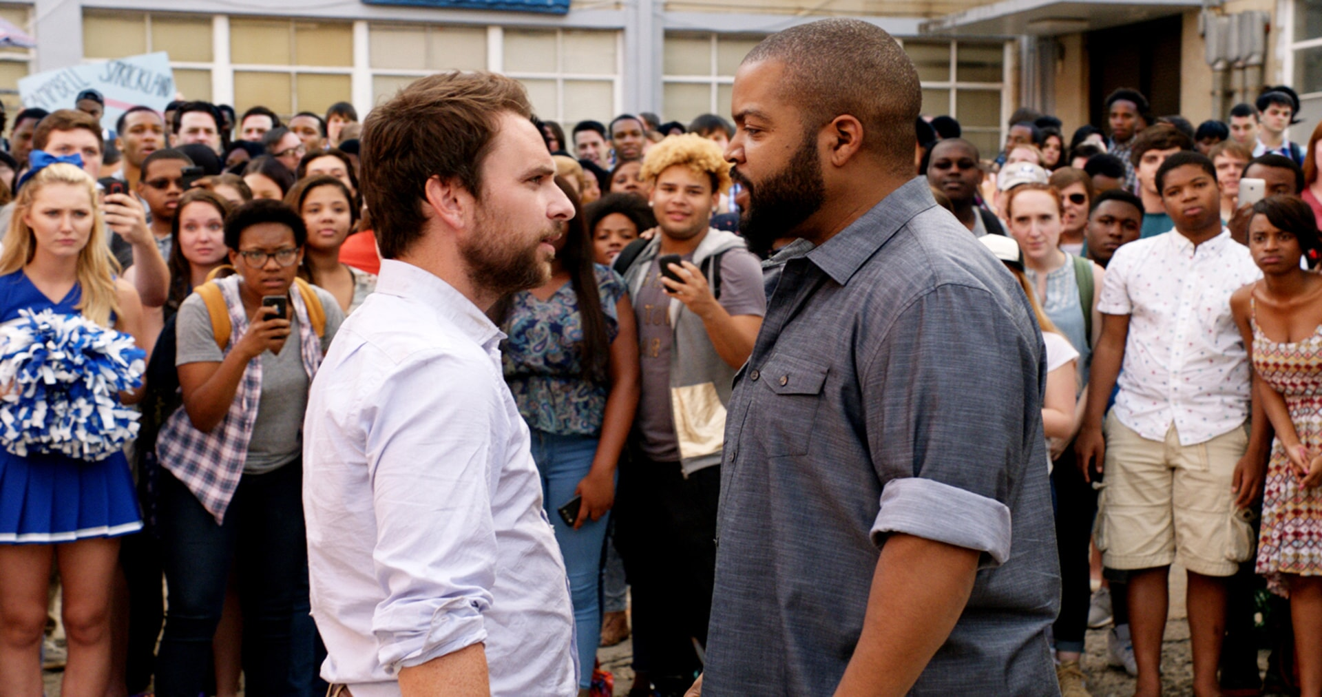 """CHARLIE DAY as Andy Campbell and ICE CUBE as Ron Strickland in the New Line Cinema and Village Roadshow Pictures comedy """"FIST FIGHT,"""" a Warner Bros. Pictures release."""