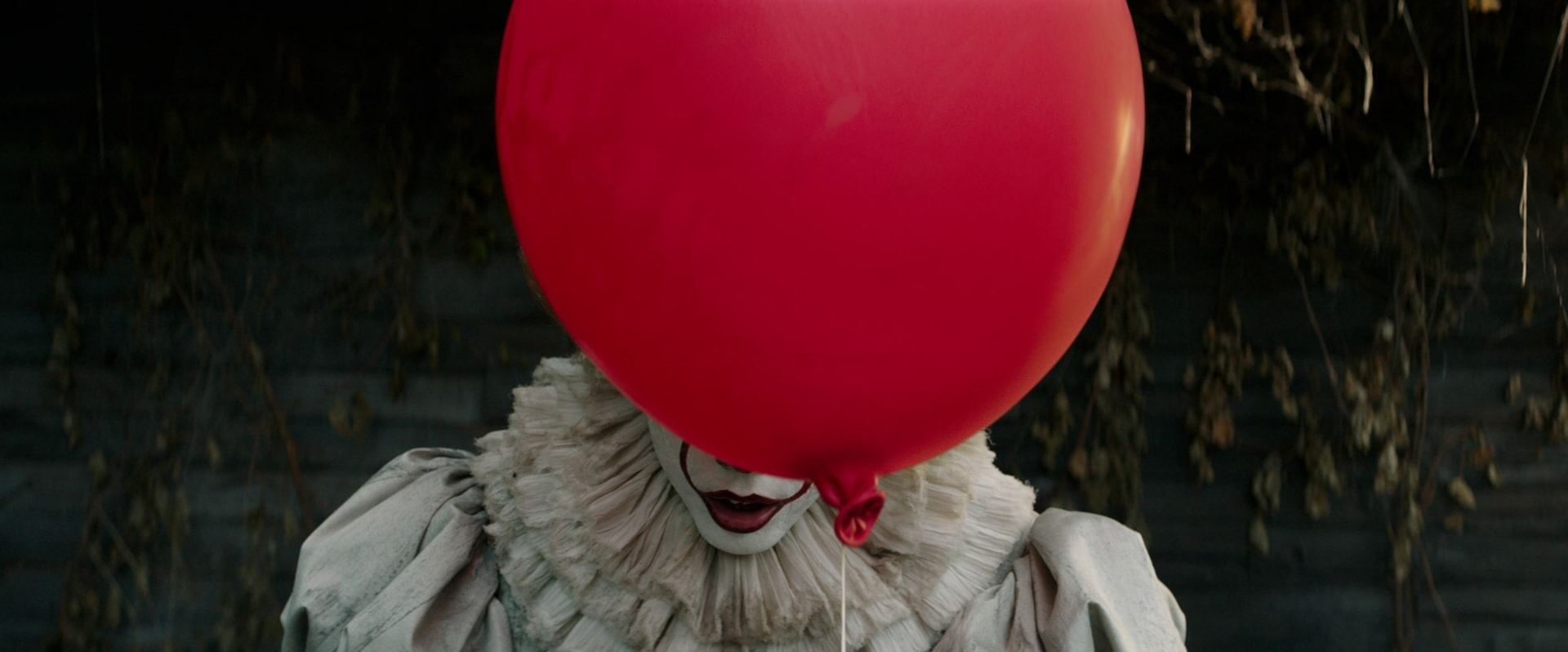 "BILL SKARSG¿RD as Pennywise in New Line Cinema's horror thriller ""IT,"" a Warner Bros. Pictures release."