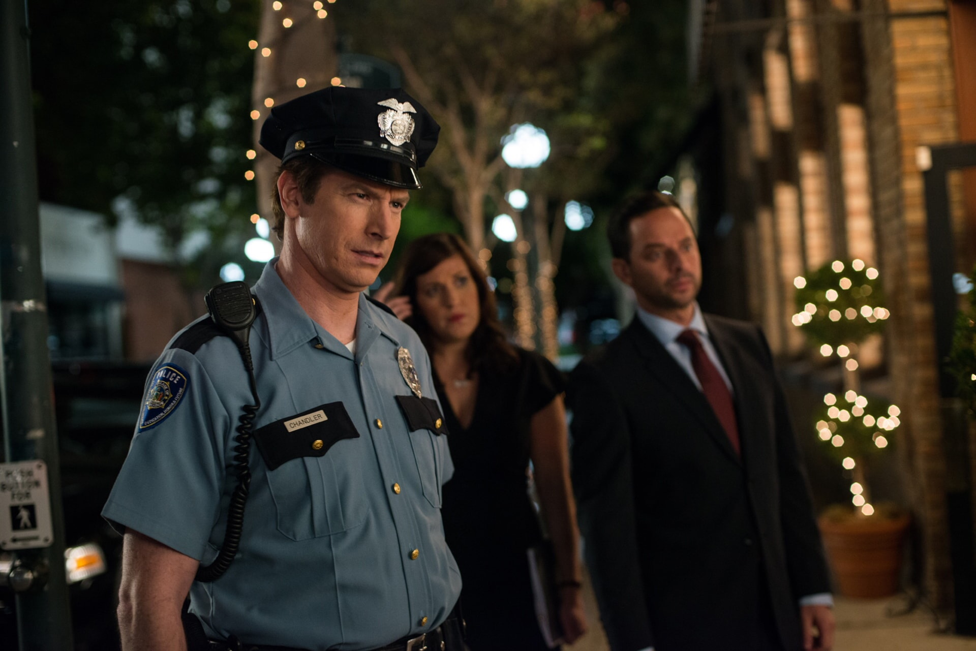 "ROB HUEBEL as Officer Chandler, ALLISON TOLMAN as Dawn and NICK KROLL as Bob in the New Line Cinema and Village Roadshow Pictures comedy ""THE HOUSE,"" a Warner Bros. Pictures release."