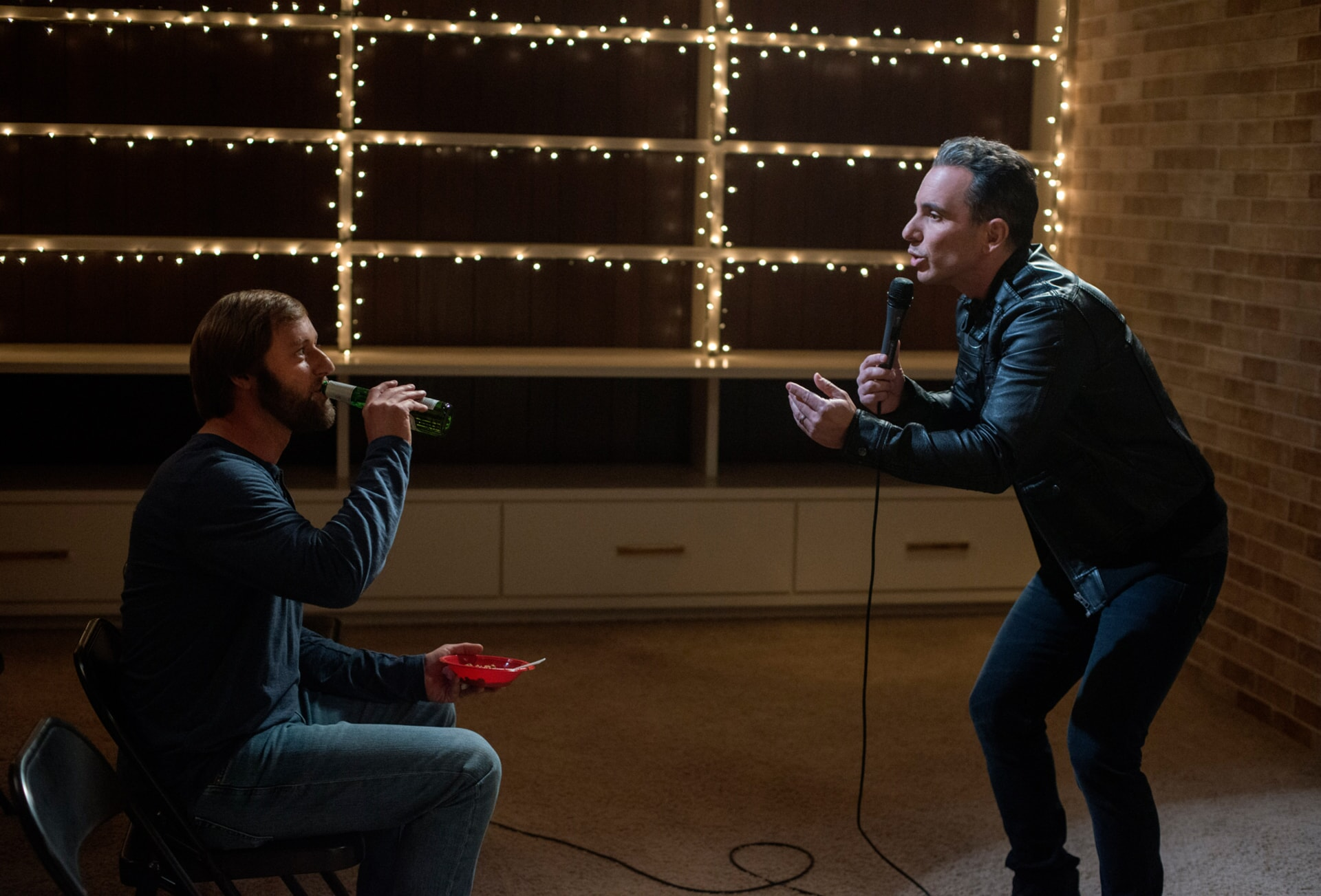 "RORY SCOVEL as Joe and SEBASTIAN MANISCALCO as Stand-up Comic in the New Line Cinema and Village Roadshow Pictures comedy ""THE HOUSE,"" a Warner Bros. Pictures release."