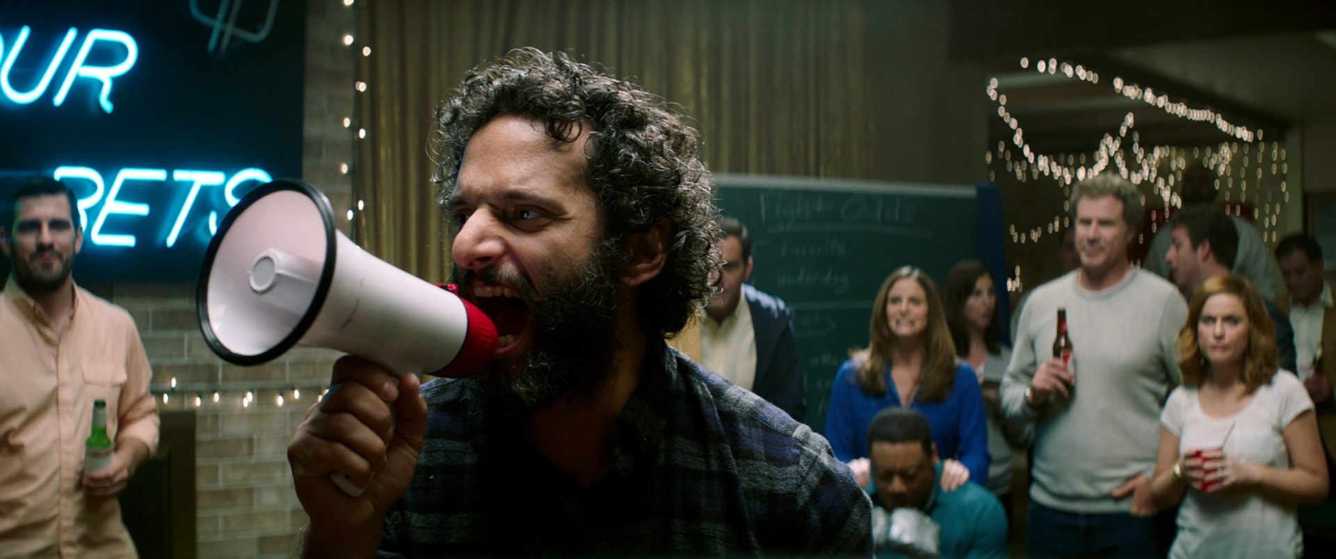 "JASON MANTZOUKAS as Frank, CEDRIC YARBROUGH as Reggie, ANDREA SAVAGE as Laura, WILL FERRELL as Scott Johansen and AMY POEHLER as Kate Johansen in the New Line Cinema and Village Roadshow Pictures comedy ""THE HOUSE,"" a Warner Bros. Pictures release."