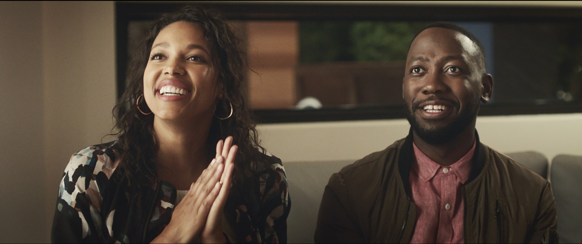 """KYLIE BUNBURY as Michelle and LAMORNE MORRIS as Kevin in New Line Cinema's action comedy """"GAME NIGHT,"""" a Warner Bros. Pictures release."""