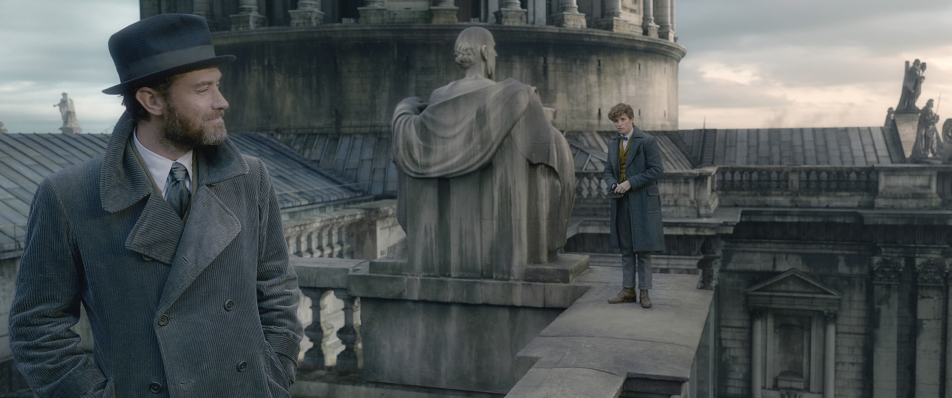 """(L-R) JUDE LAW as young ALBUS DUMBLEDORE and EDDIE REDMAYNE as Newt Scamander in Warner Bros. Pictures' fantasy adventure """"FANTASTIC BEASTS: THE CRIMES OF GRINDELWALD,"""" a Warner Bros. Pictures release."""