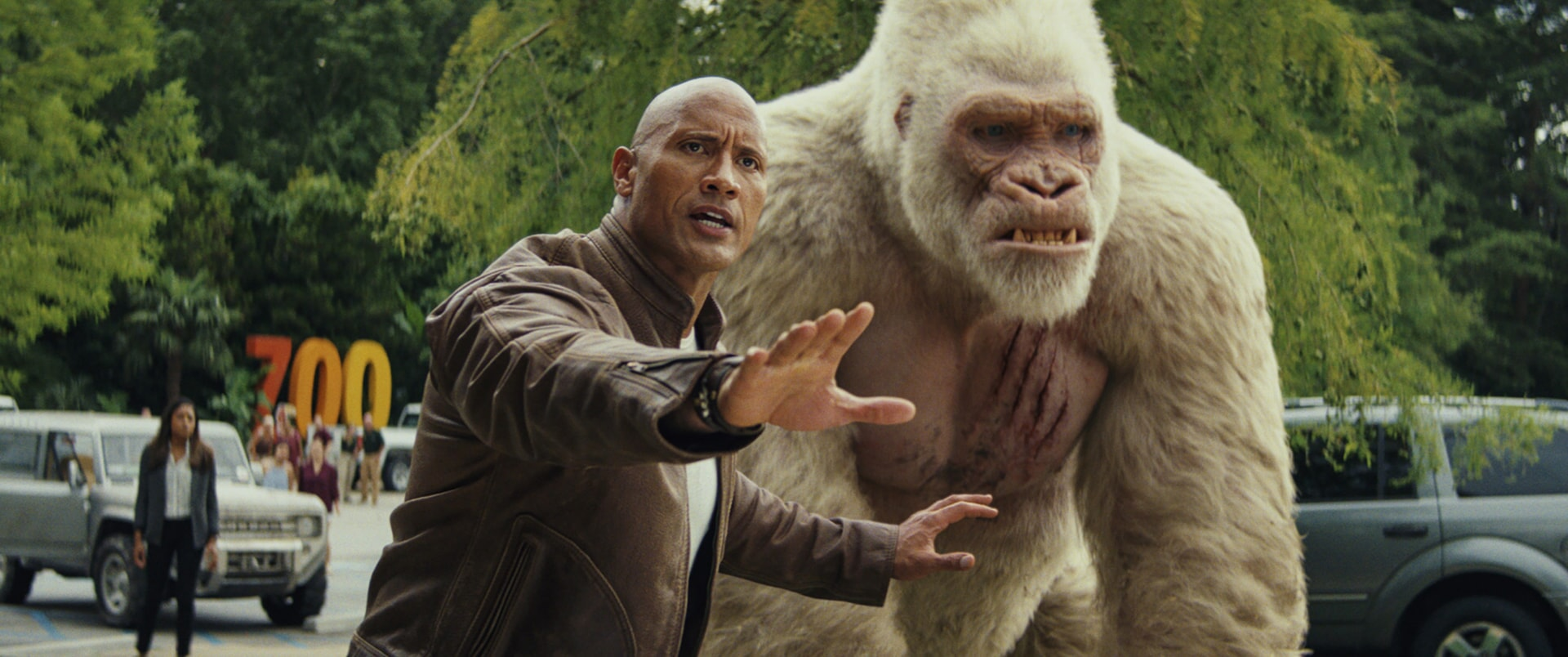 """(L-R) DWAYNE JOHNSON as Davis Okoye and JASON LILES as George in New Line Cinema's and ASAP Entertainment's action adventure """"RAMPAGE,"""" a Warner Bros. Pictures release."""