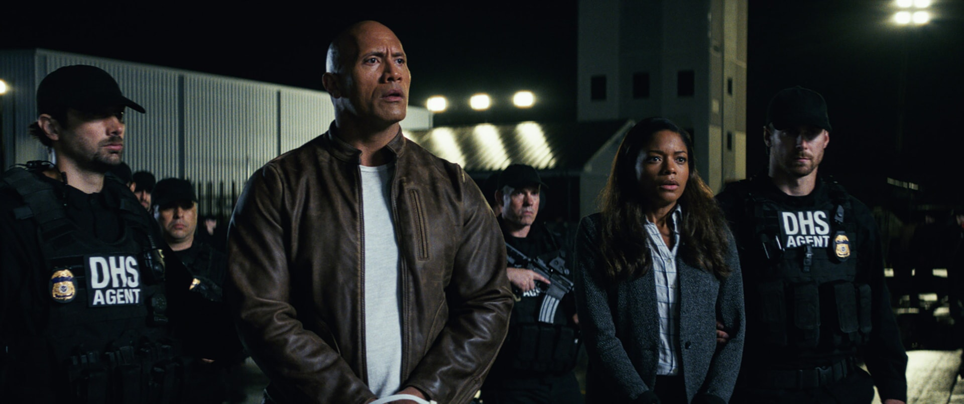 """(Center L-R) DWAYNE JOHNSON as Davis Okoye and NAOMIE HARRIS as Dr. Kate Caldwell in New Line Cinema's and ASAP Entertainment's action adventure """"RAMPAGE,"""" a Warner Bros. Pictures release."""