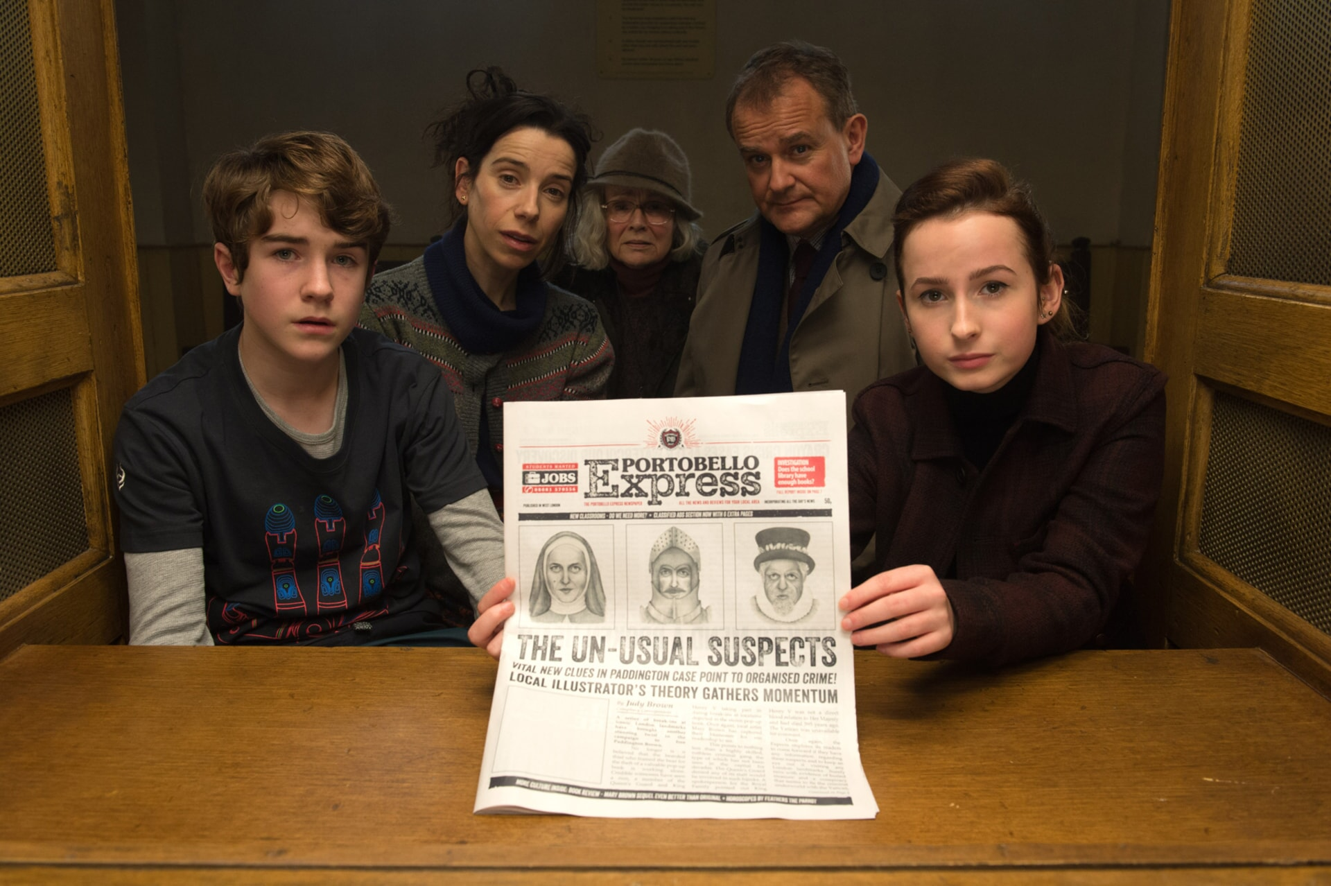 """SAMUEL JOSLIN as Jonathan Brown, SALLY HAWKINS as Mary Brown, JULIE WALTERS as Mrs. Bird, HUGH BONNEVILLE as Henry Brown and MADELEINE HARRIS as Judy Brown in the family adventure """"PADDINGTON 2,"""" from Warner Bros. Pictures and STUDIOCANAL, in association with Anton Capital Entertainment S.C.A., a Warner Bros. Pictures release."""