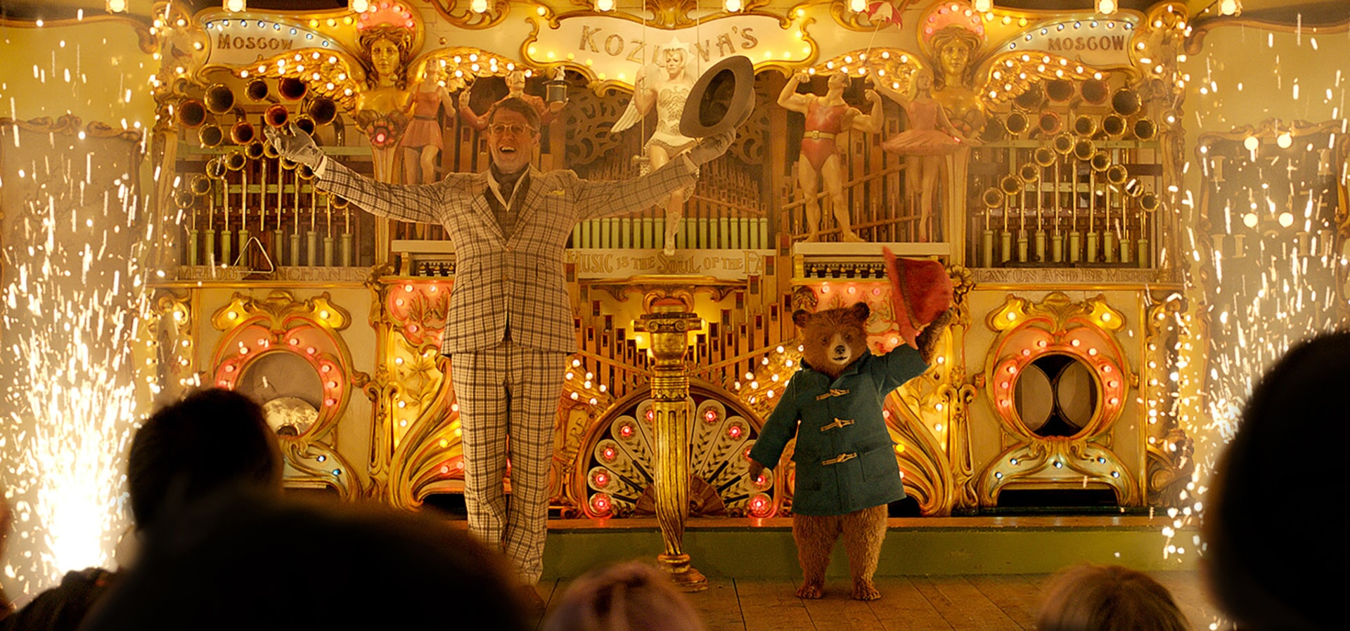 """HUGH GRANT as Phoenix Buchanan and Paddington voiced by BEN WHISHAW in the family adventure """"PADDINGTON 2,"""" from Warner Bros. Pictures and STUDIOCANAL, in association with Anton Capital Entertainment S.C.A., a Warner Bros. Pictures release."""