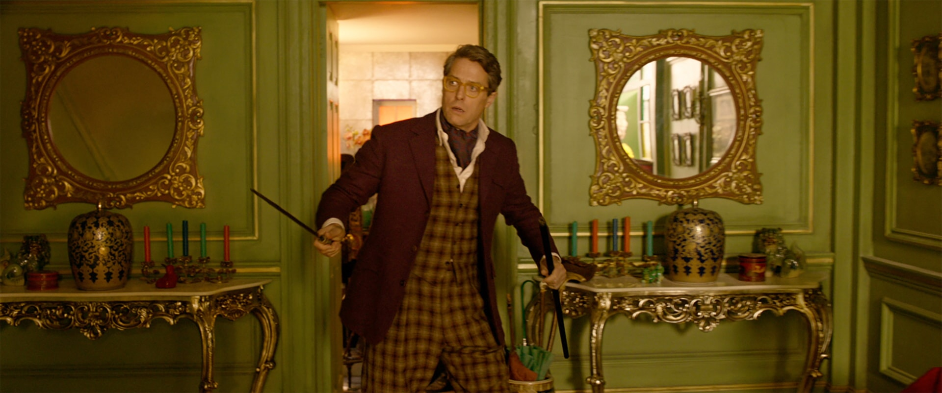 """HUGH GRANT as Phoenix Buchanan in the family adventure """"PADDINGTON 2,"""" from Warner Bros. Pictures and STUDIOCANAL, in association with Anton Capital Entertainment S.C.A., a Warner Bros. Pictures release."""