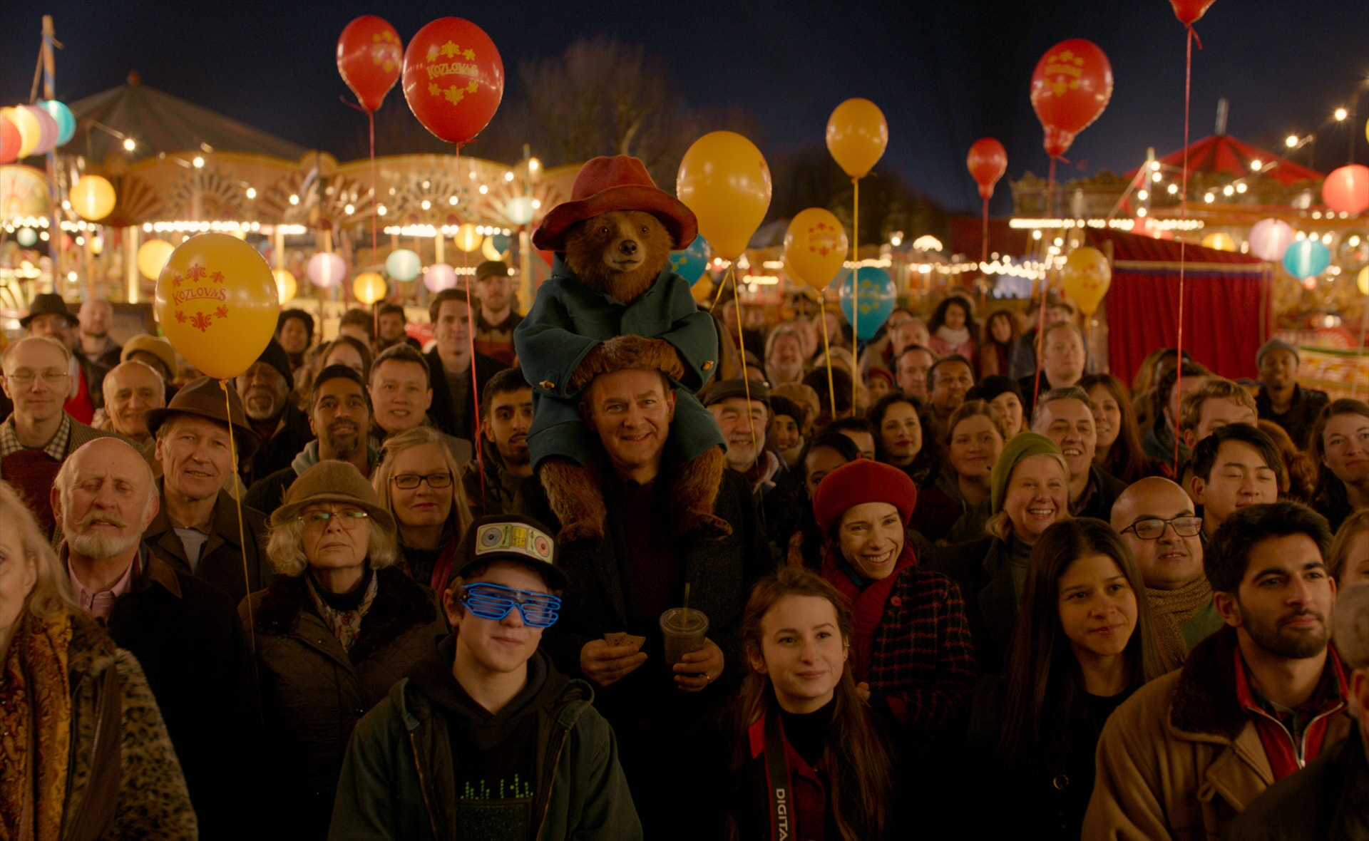 """JULIE WALTERS as Mrs. Bird, SAMUEL JOSLIN as Jonathan Brown, Paddington voiced by BEN WHISHAW, HUGH BONNEVILLE as Henry Brown, MADELEINE HARRIS as Judy Brown and SALLY HAWKINS as Mary Brown in the family adventure """"PADDINGTON 2,"""" from Warner Bros. Pictures and STUDIOCANAL, in association with Anton Capital Entertainment S.C.A., a Warner Bros. Pictures release."""