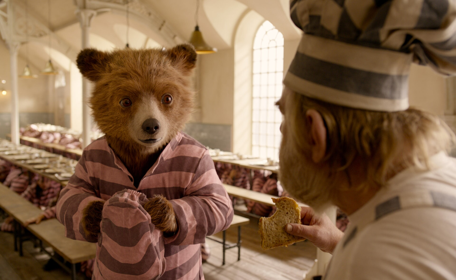 """Paddington voiced by BEN WHISHAW and BRENDAN GLEESON as Knuckles McGinty in the family adventure """"PADDINGTON 2,"""" from Warner Bros. Pictures and STUDIOCANAL, in association with Anton Capital Entertainment S.C.A., a Warner Bros. Pictures release."""