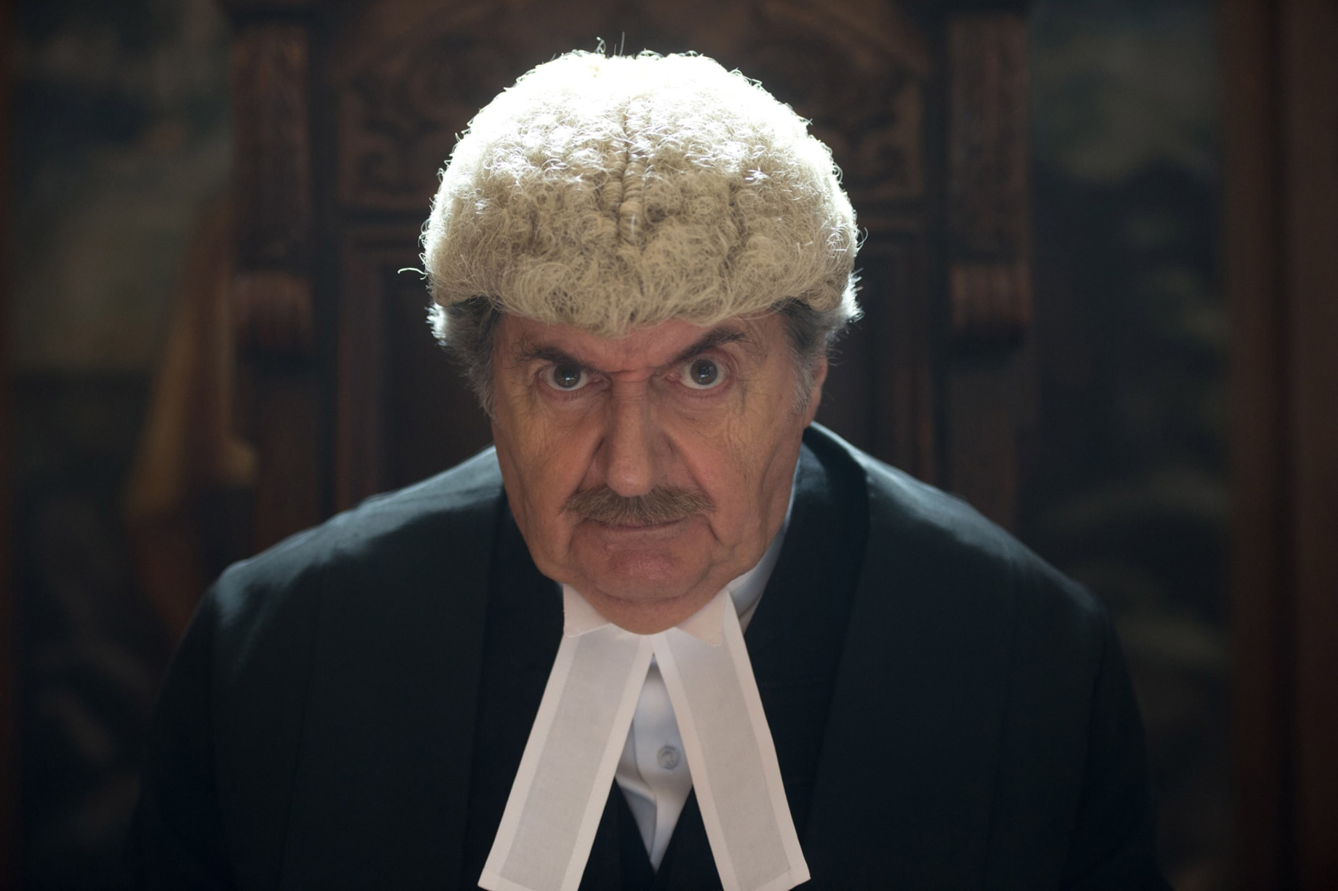 """TOM CONTI as Judge Gerald Biggleswade in the family adventure """"PADDINGTON 2,"""" from Warner Bros. Pictures and STUDIOCANAL, in association with Anton Capital Entertainment S.C.A., a Warner Bros. Pictures release."""