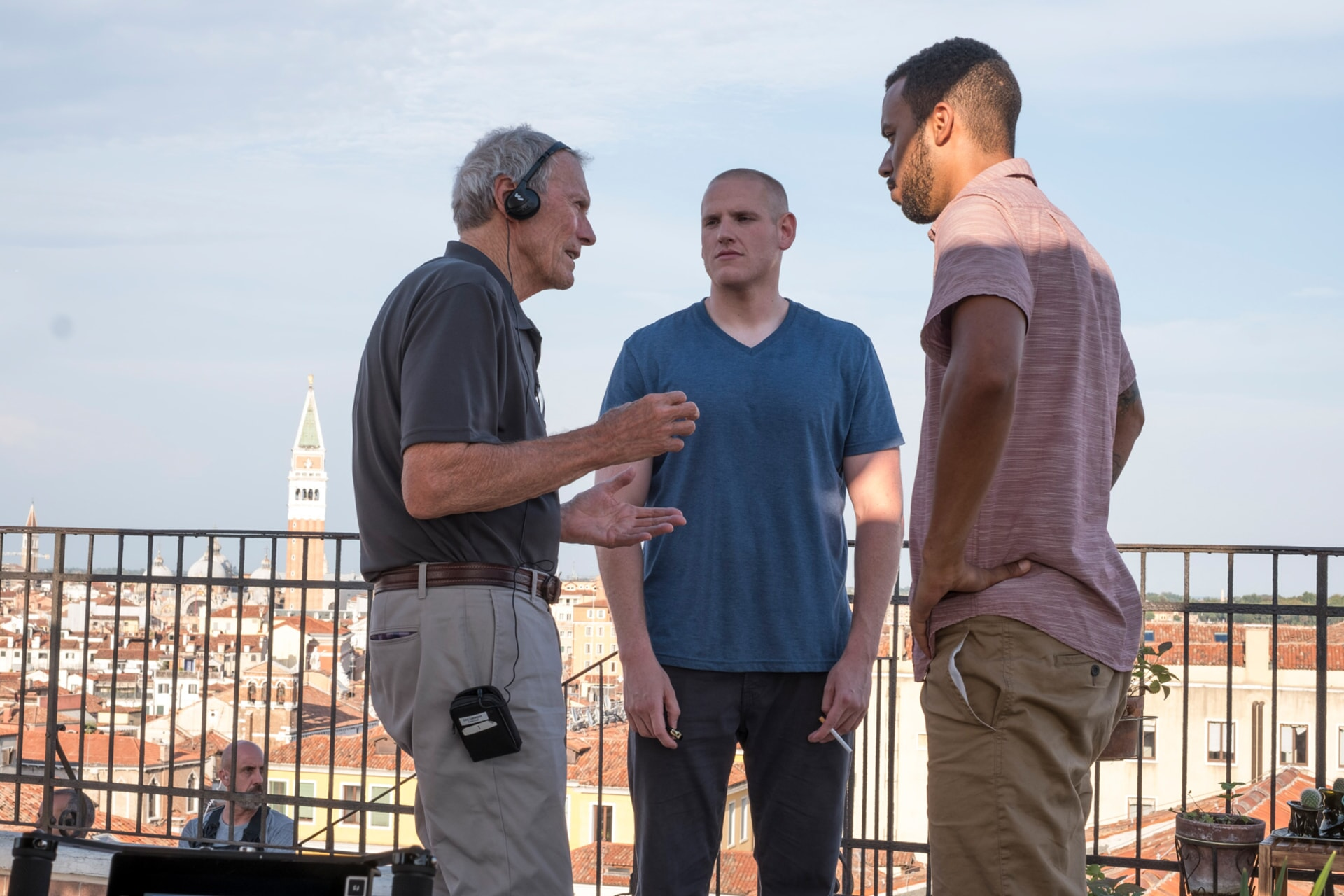 """(L-R) Director/producer CLINT EASTWOOD, SPENCER STONE and ANTHONY SADLER on the set of Warner Bros. Pictures' and Village Roadshow Pictures' """"THE 15:17 TO PARIS,"""" a Warner Bros. Pictures release."""